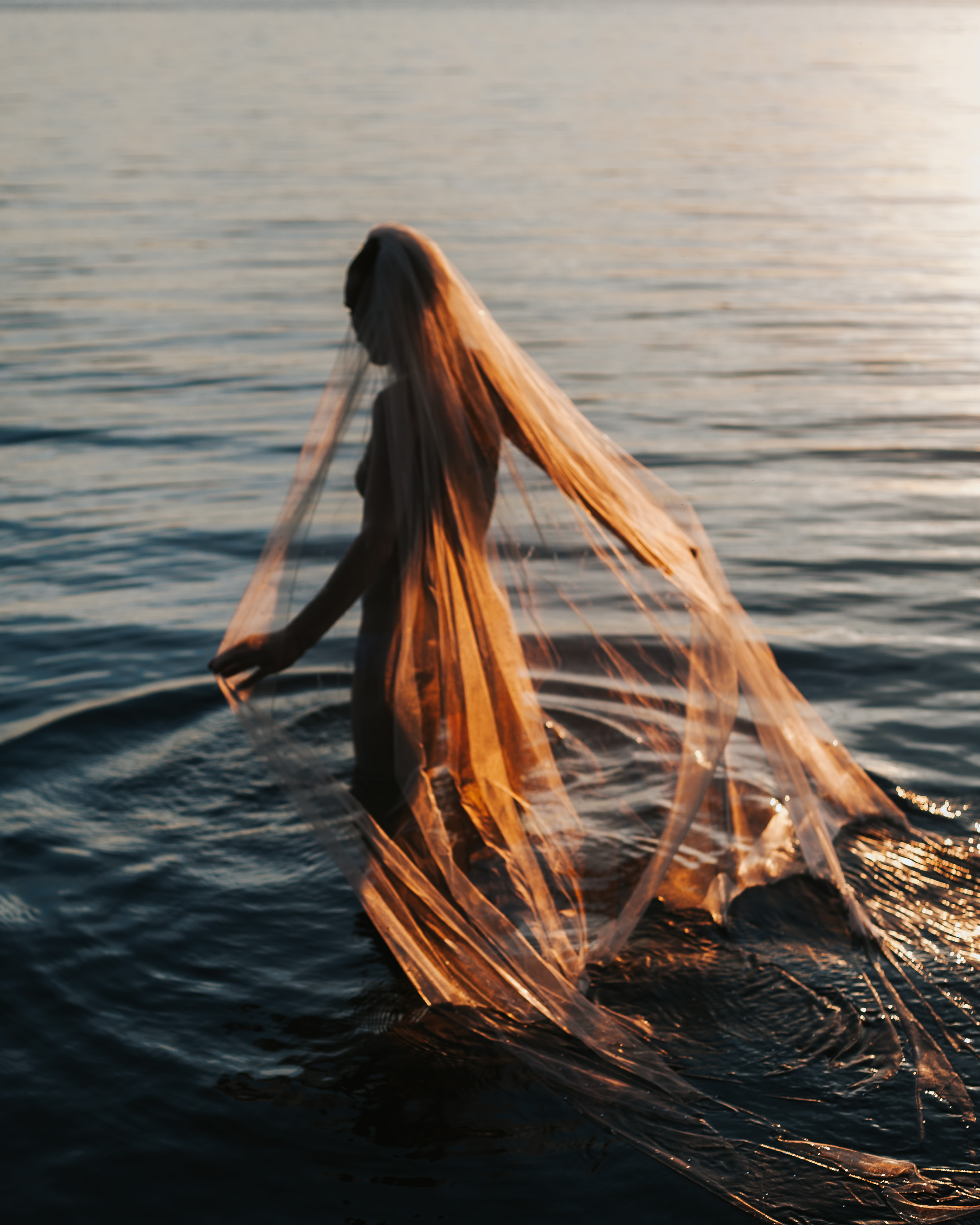 Shadow bride standing in water- photo by Joel and Justyna