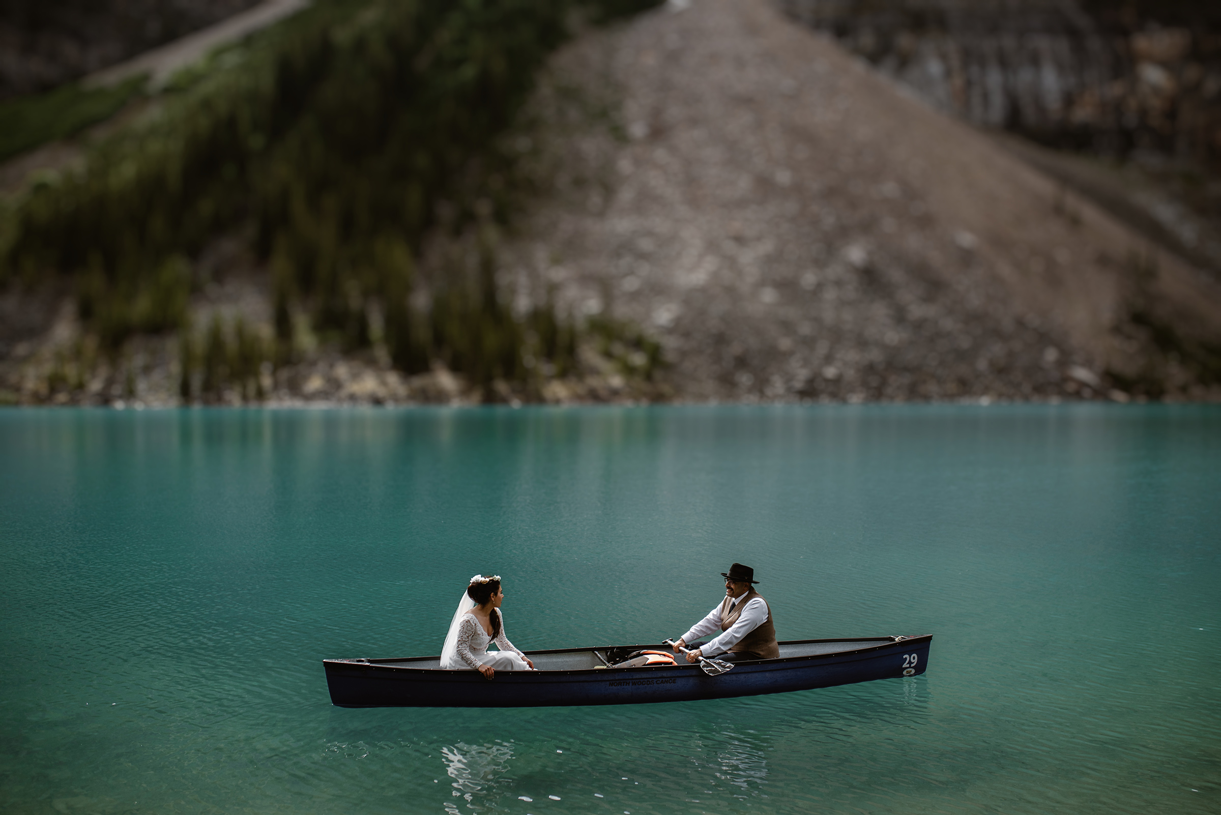 Elopement couple in canoe on water - photo by Virginia & Evan