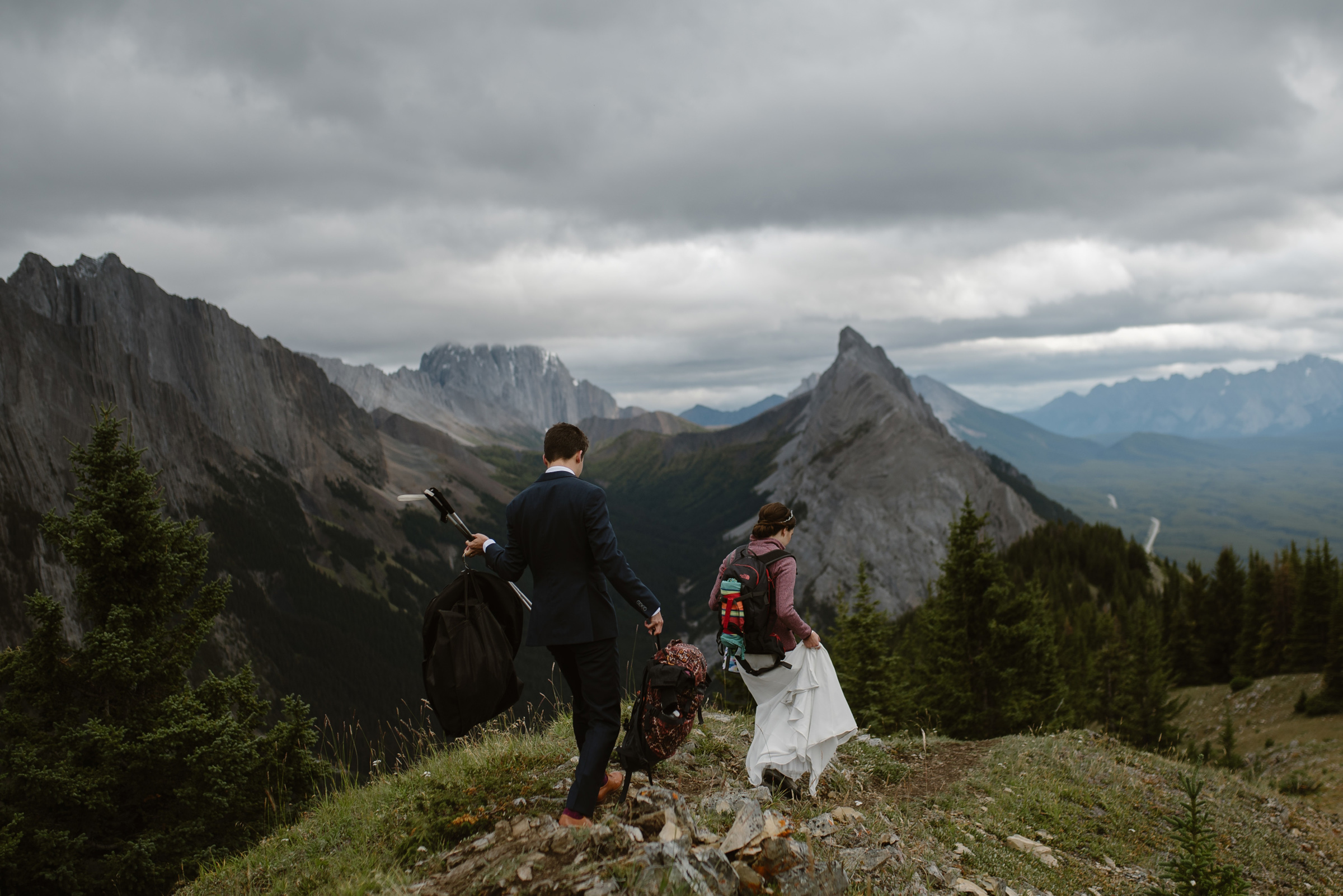 Elopement couple on mountain trail - photo by Virginia & Evan
