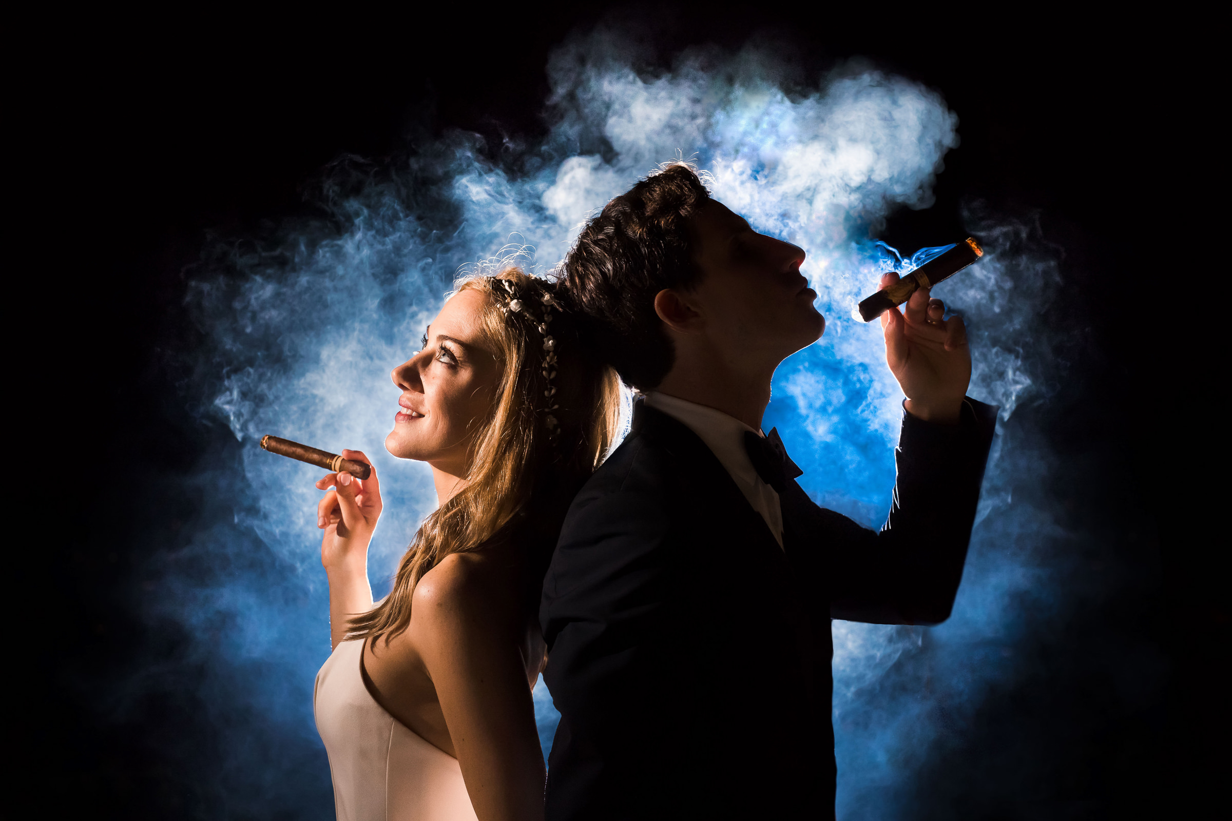 Bride and groom smoking cigars together - photo by M. Hart - Los Angeles