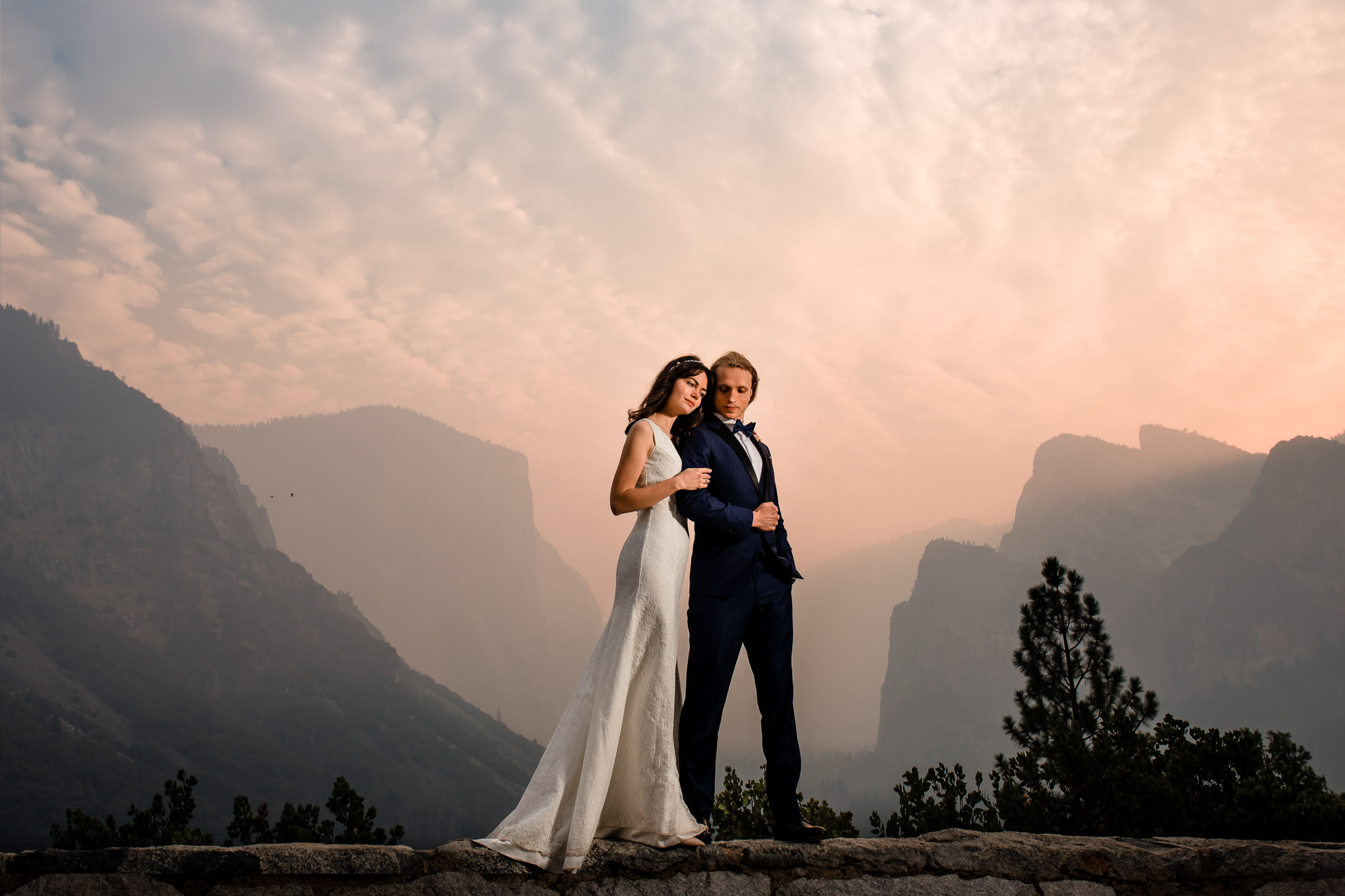 Epic portrait of couple at Yosemite Park lookout of Half Dome - photo by M. Hart