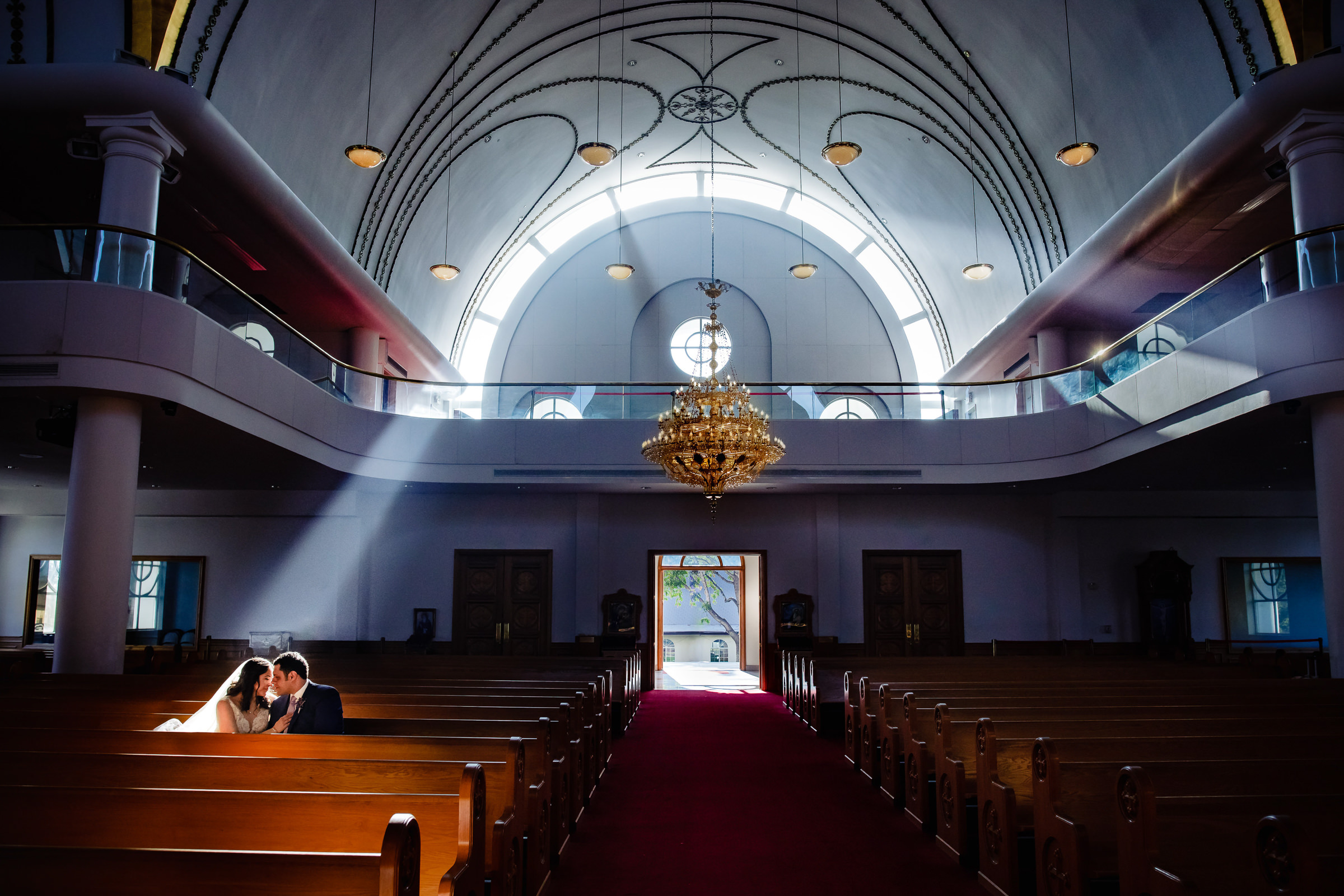 Seated couple alone in contemporary church - photo by M Hart - Los Angeles photographer