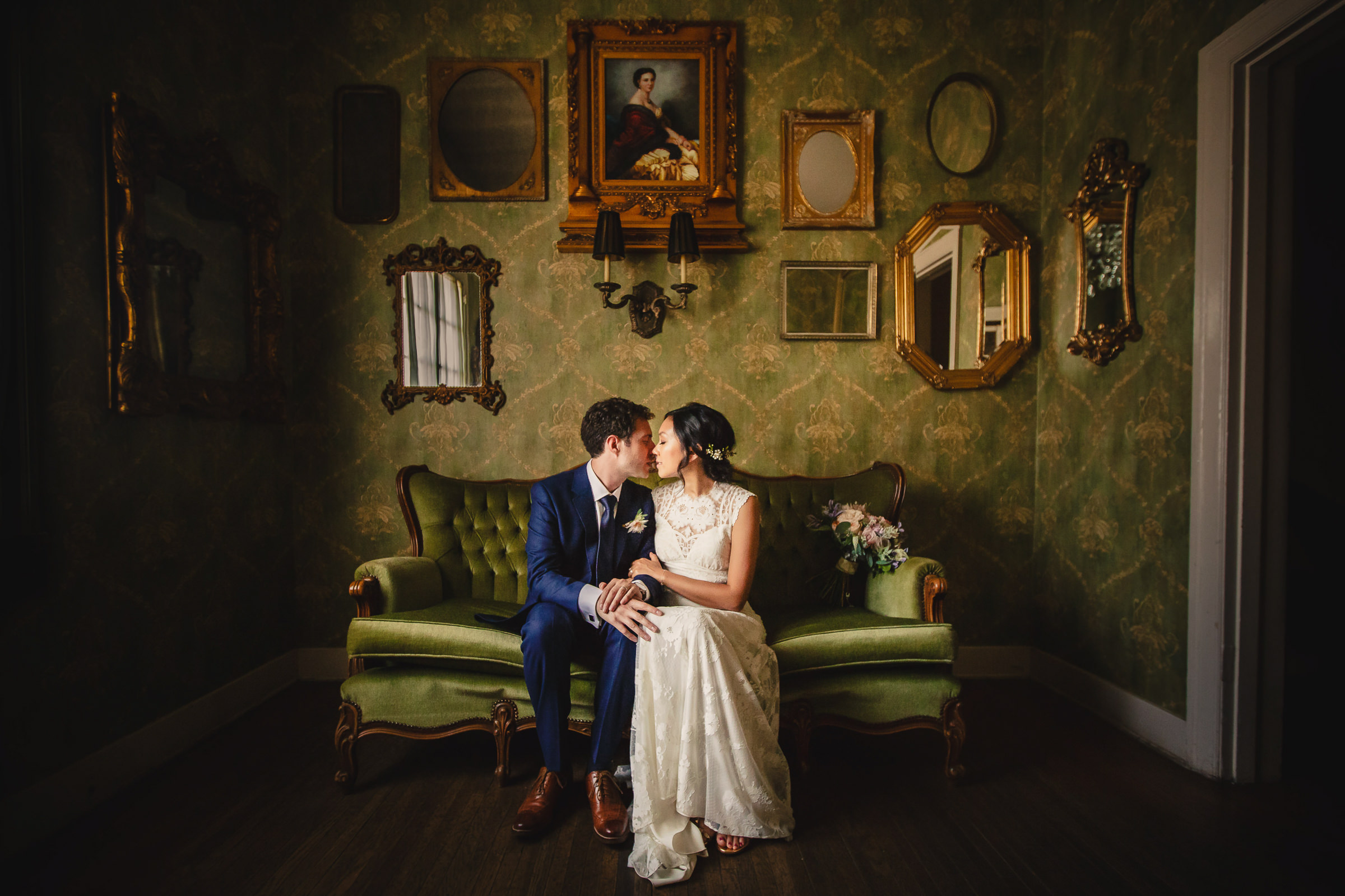 The Ebell Club - Couple kiss in antique room - photo by M. Hart - Los Angeles photographer
