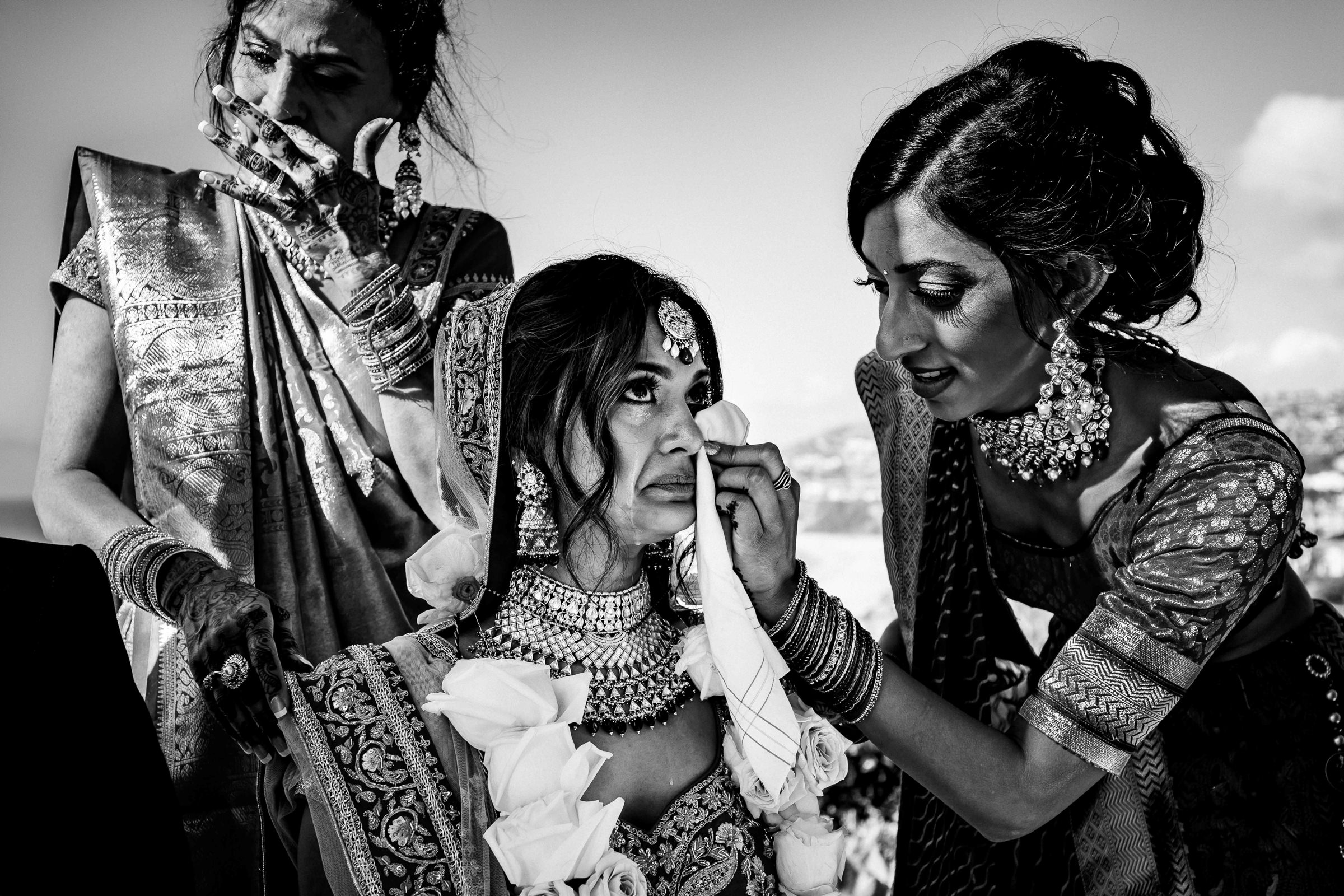 Wiping a tear for the Indian bride - photo by M. Hart - Los Angeles photographer