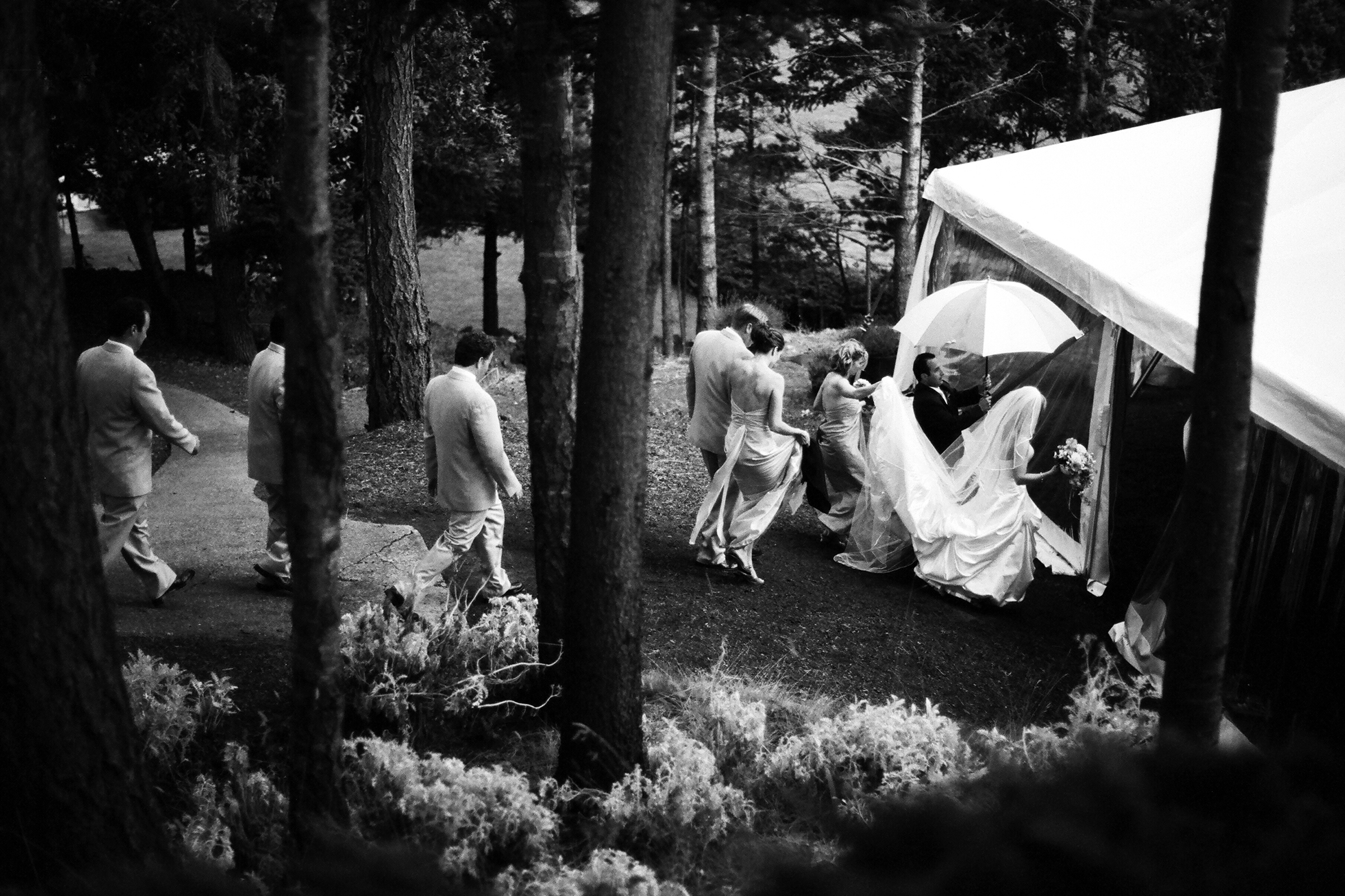 Bridal party making their way to outdoor tent - photo by Bradley Hanson Photography