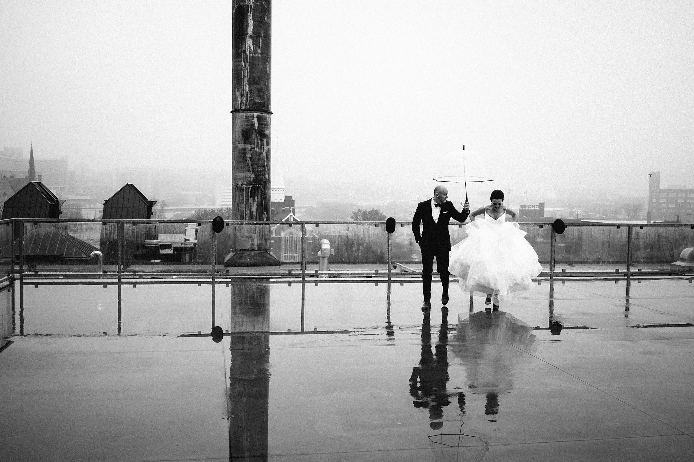 Bride and groom reflected from ground up - photo by Bradley Hanson Photography