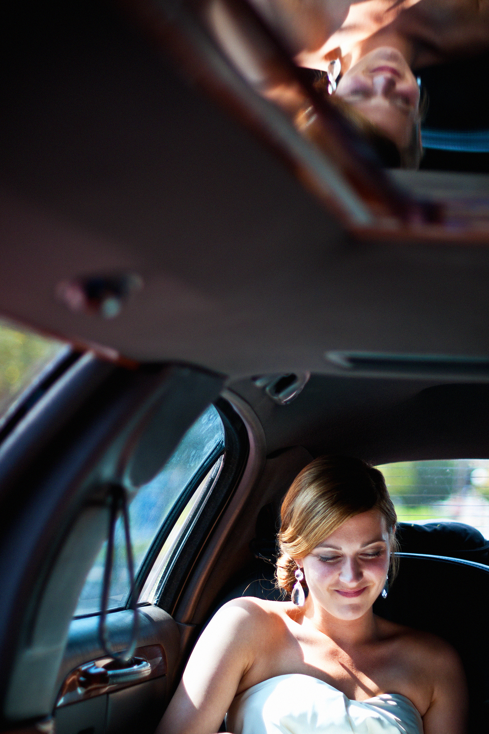 Bride in limo reflected - photo by Bradley Hanson Photography