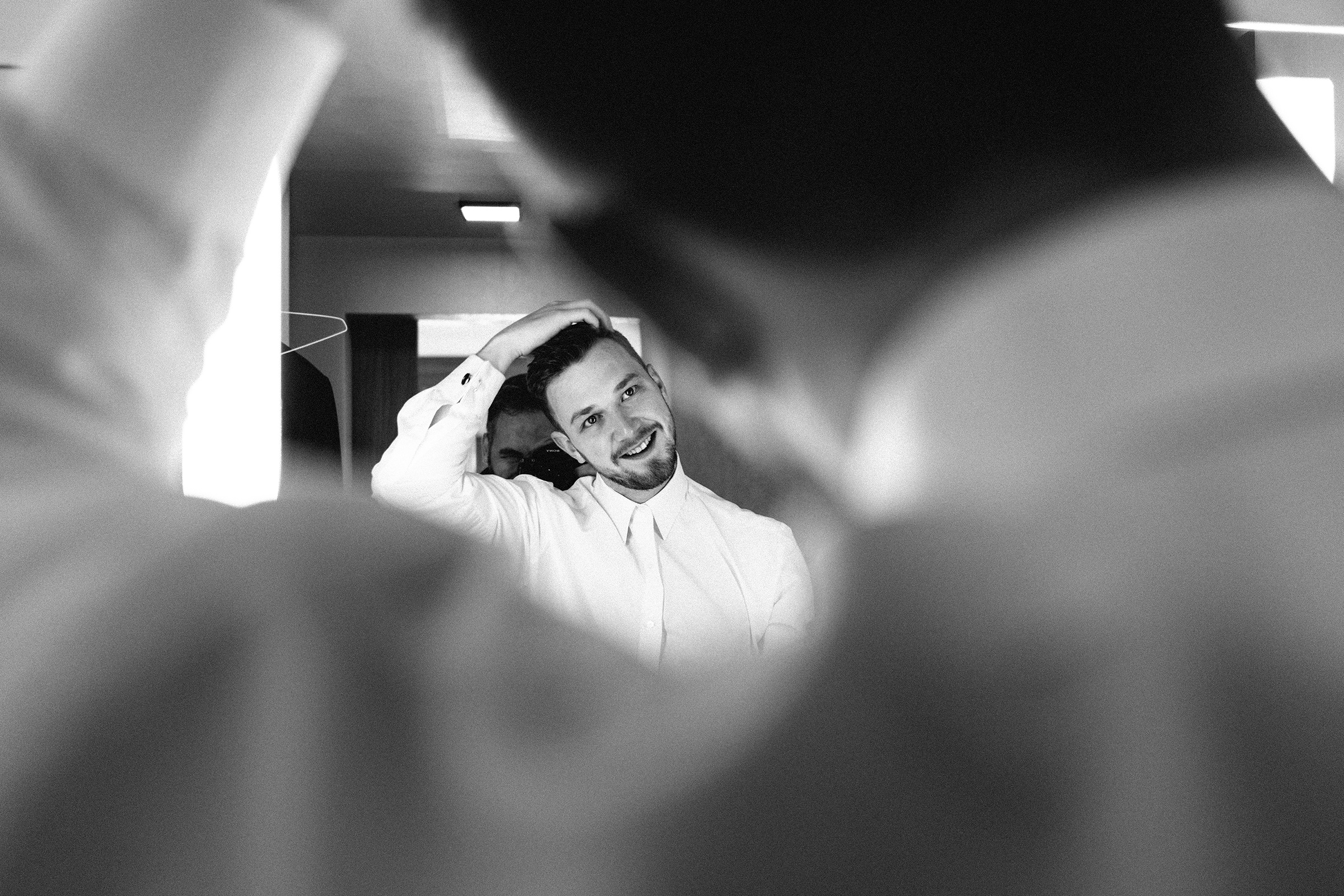 Creative composition of groom in mirror - photo by Bradley Hanson Photography