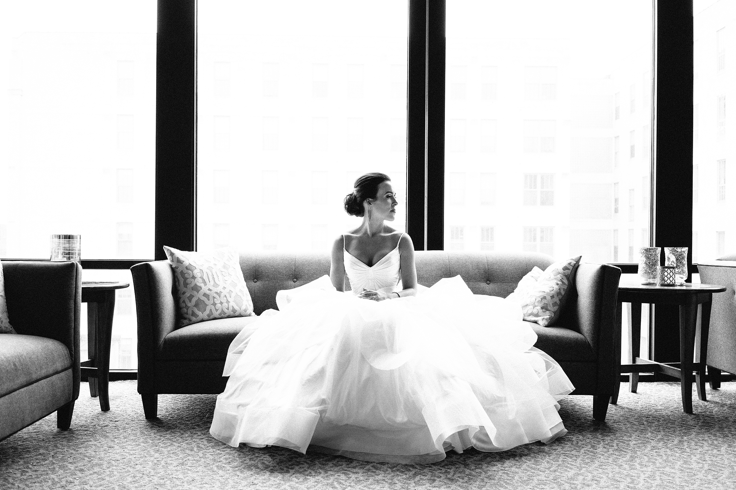 Seated bride portrait in voluminous gown- photo by Bradley Hanson Photography