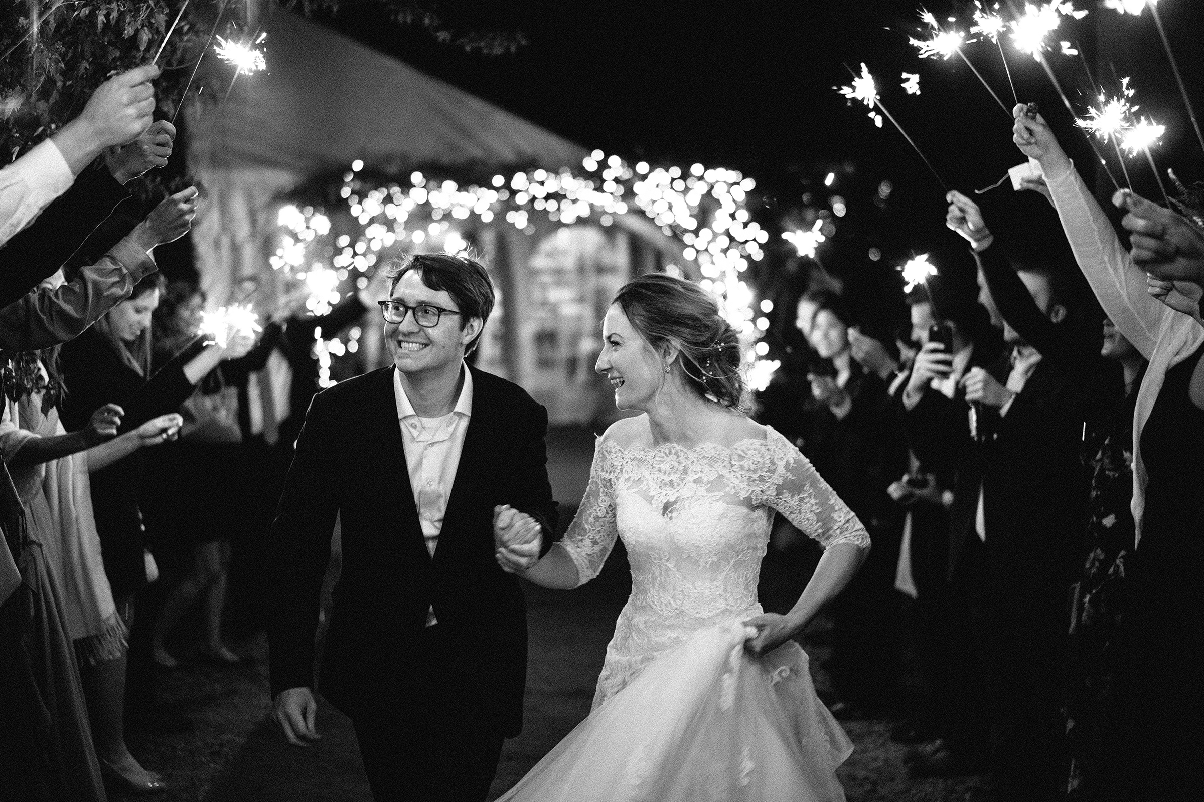 Couple exit under sparklers - photo by Bradley Hanson Photography