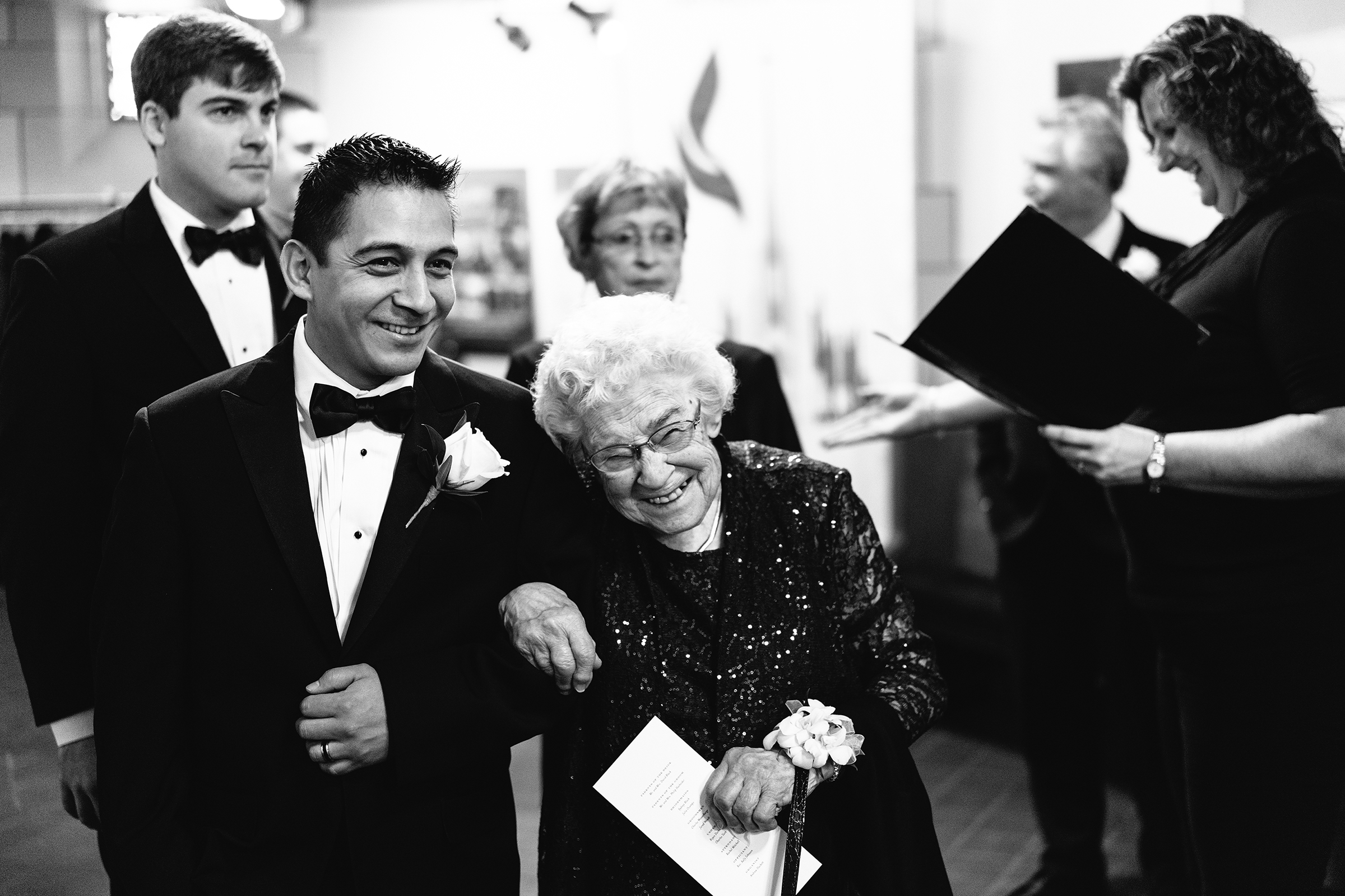 Happy grandma links arms with groom - photo by Bradley Hanson Photography