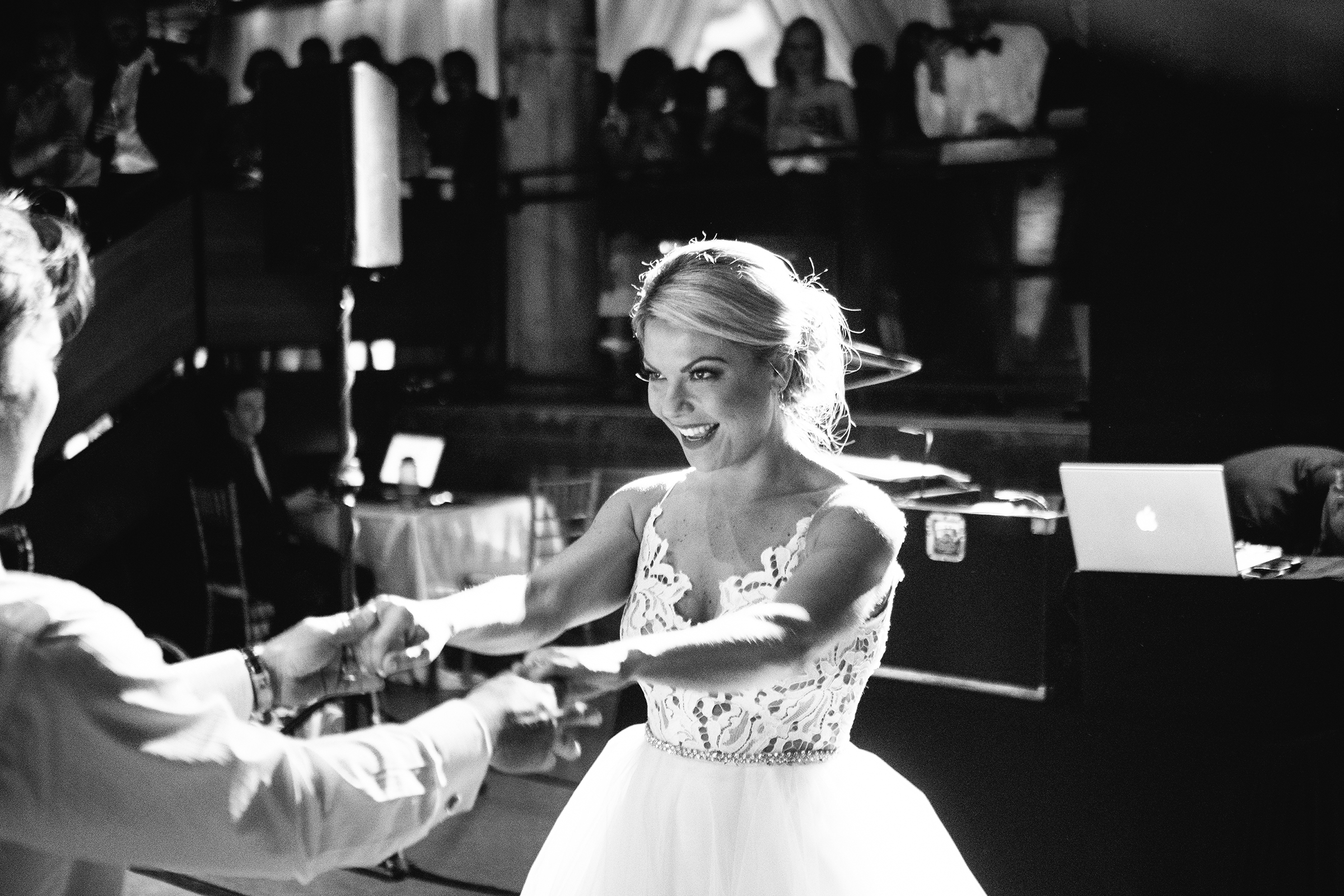 Spotlight on bride at first dance - photo by Bradley Hanson Photography
