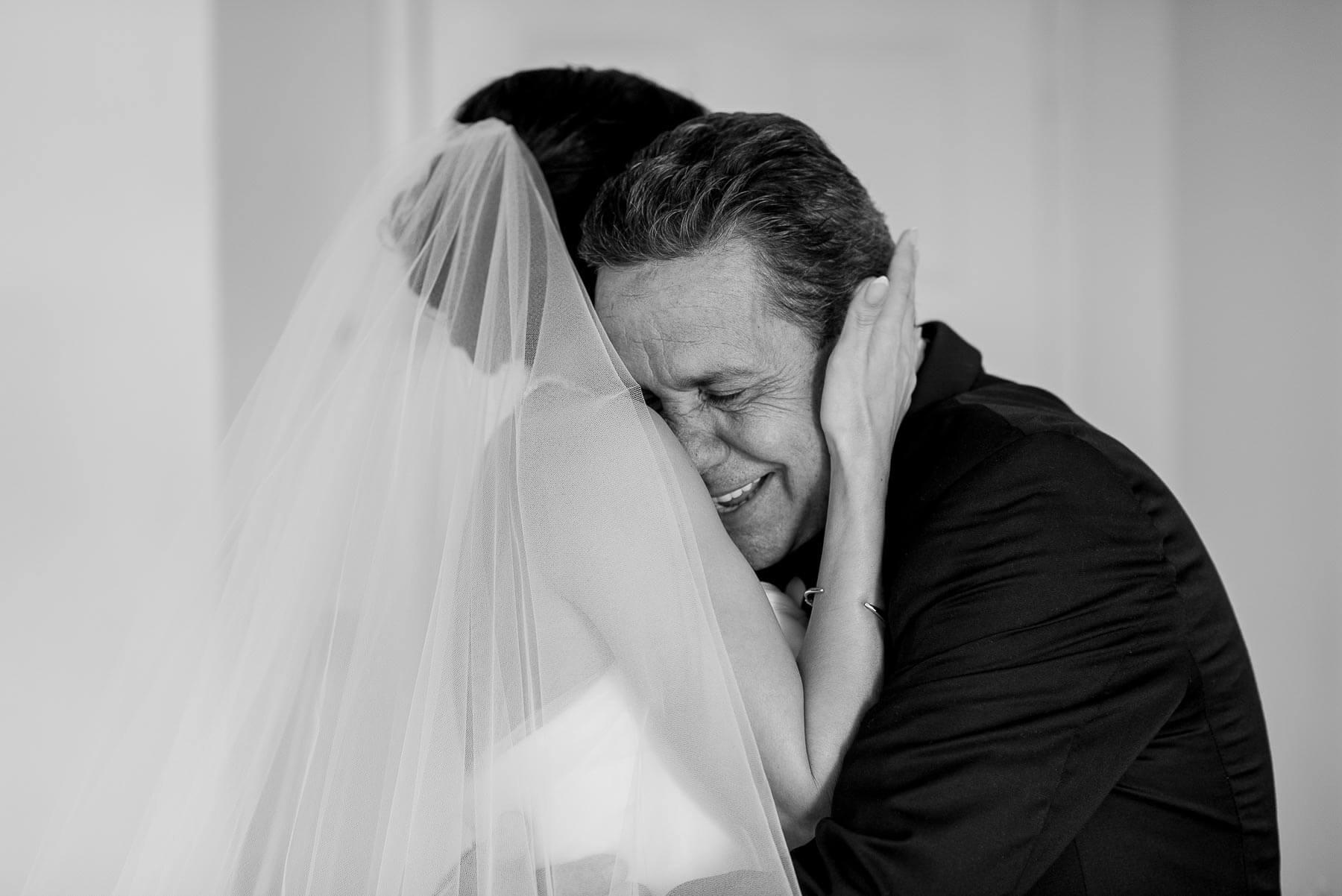 Bride embraces father - photo by Maloman Studios