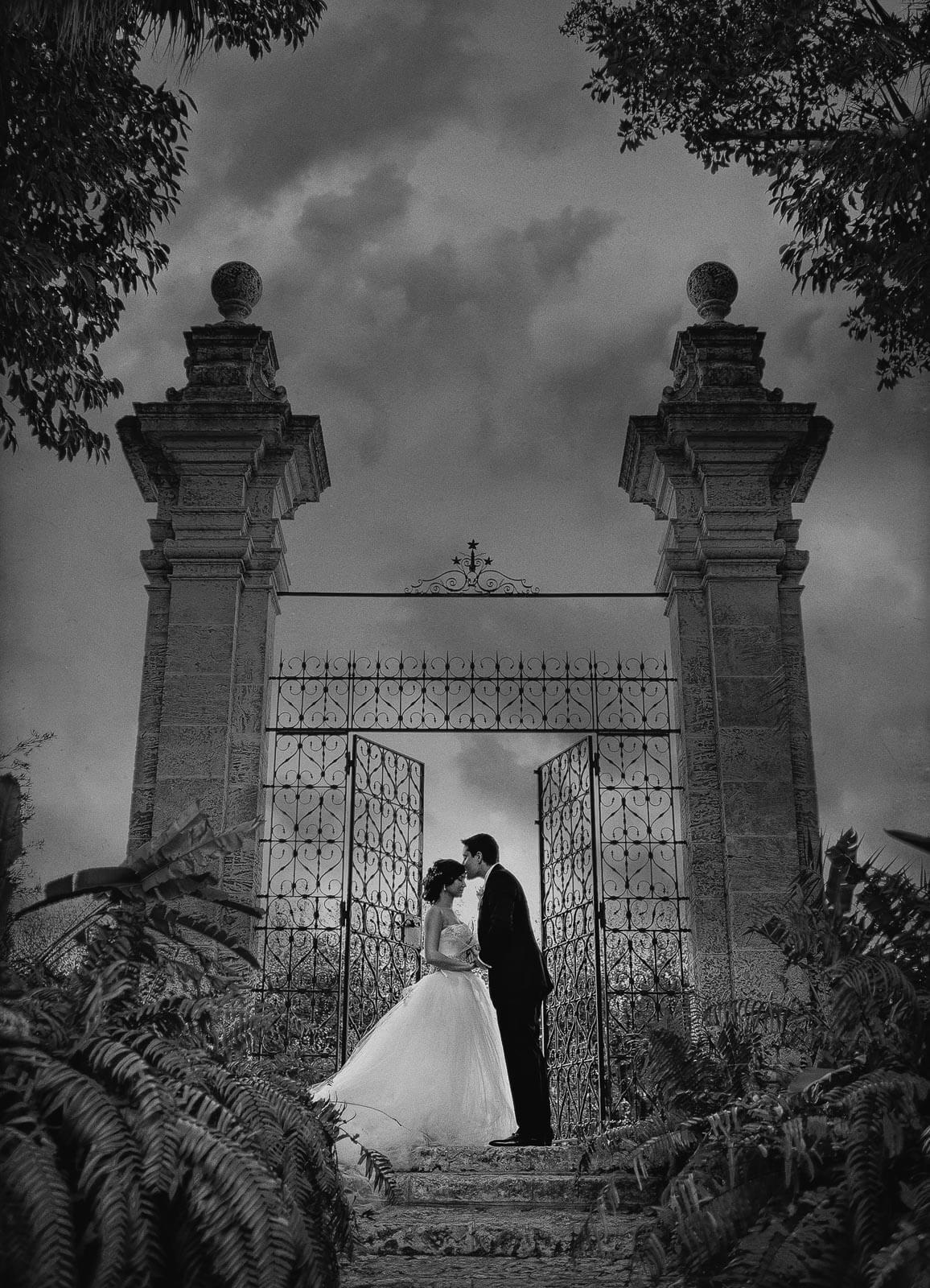 Couple at ornate gate entrance to Vizcaya - photo by Maloman Studios