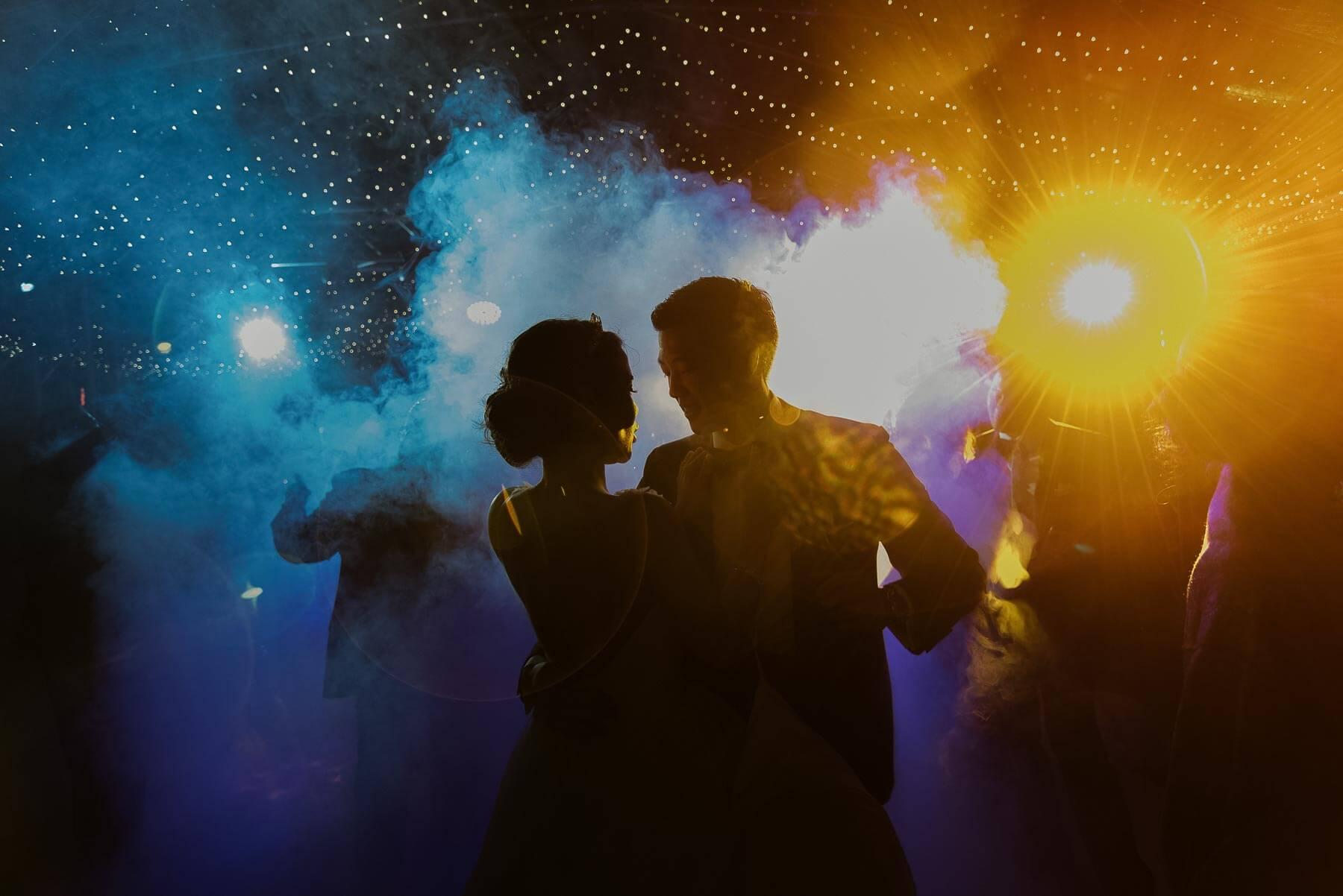 couple dance amid colored smoke and lights - photo by Maloman Studios