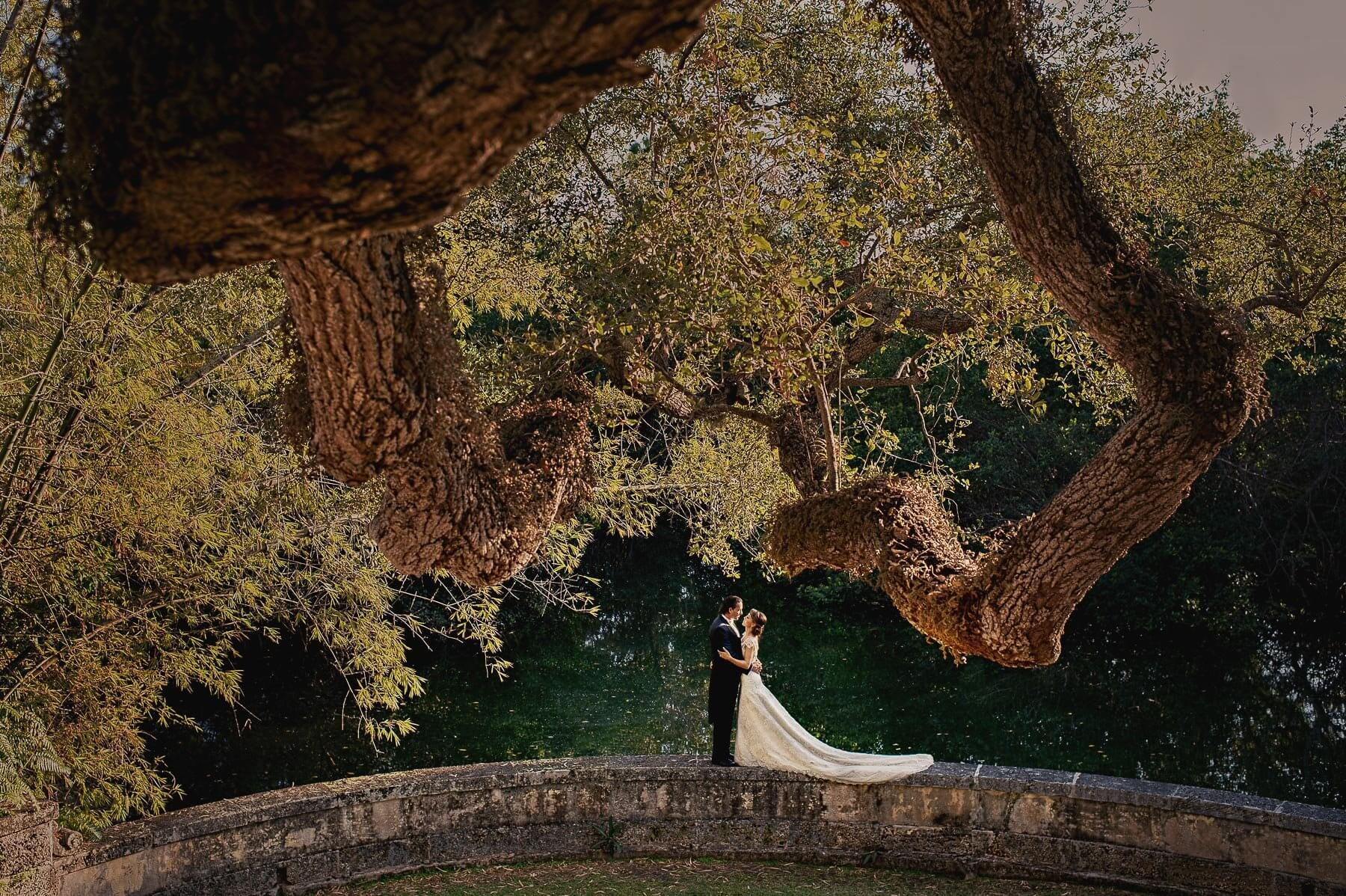 Face to face couple in epic vizcaya setting- photo by Maloman Studios