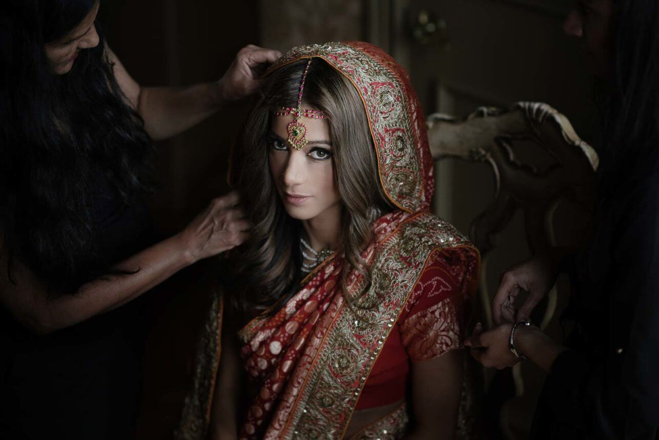 Getting the bride ready - photo by Maloman Studios