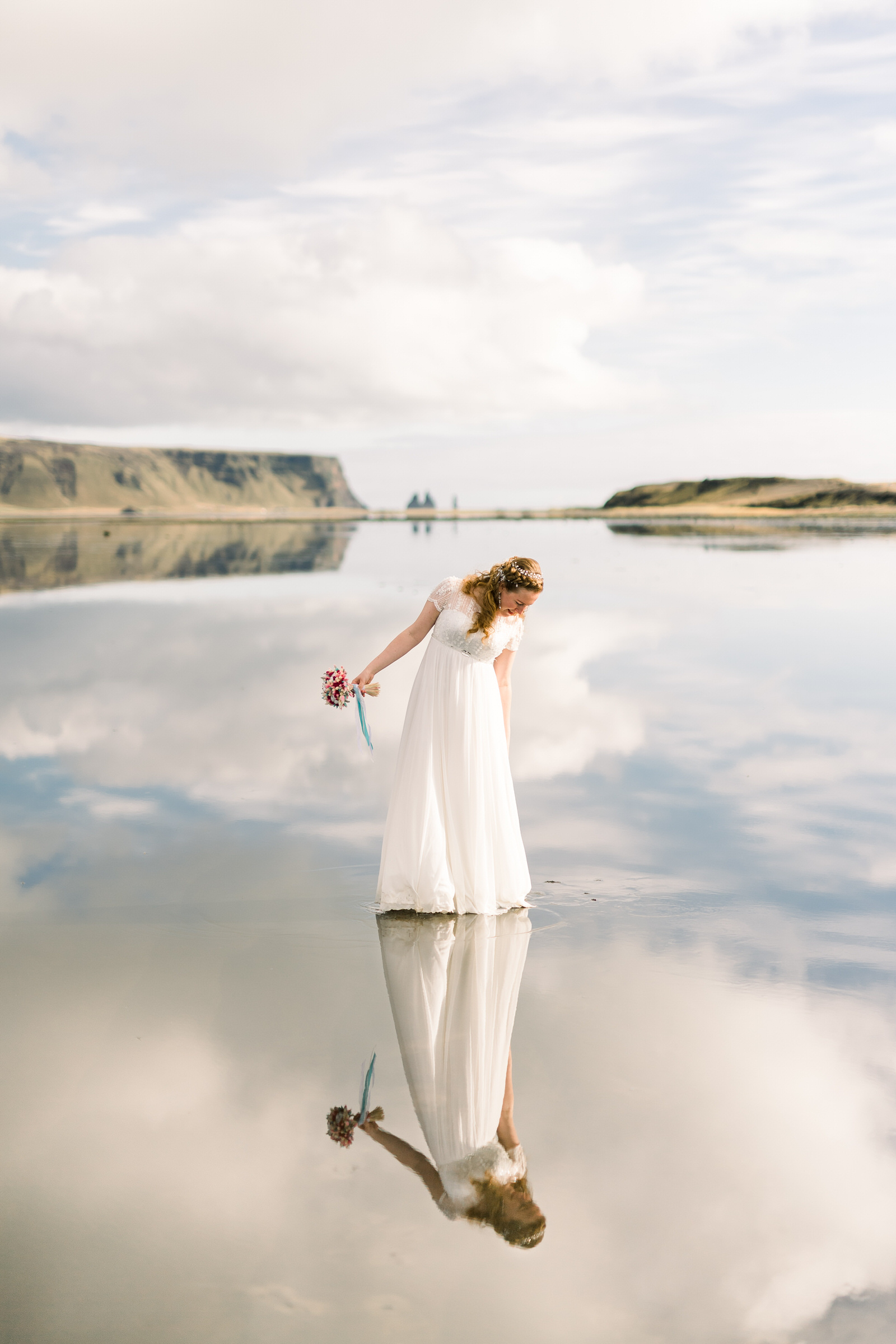 Bride reflected outdoors in Iceland - photo by M&J Studios