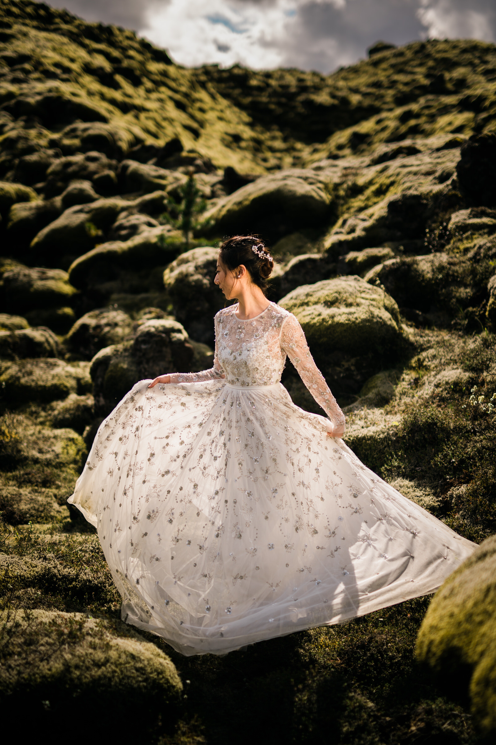 Bride shows off elopement gown in Iceland landscape - photo by M&J Studios