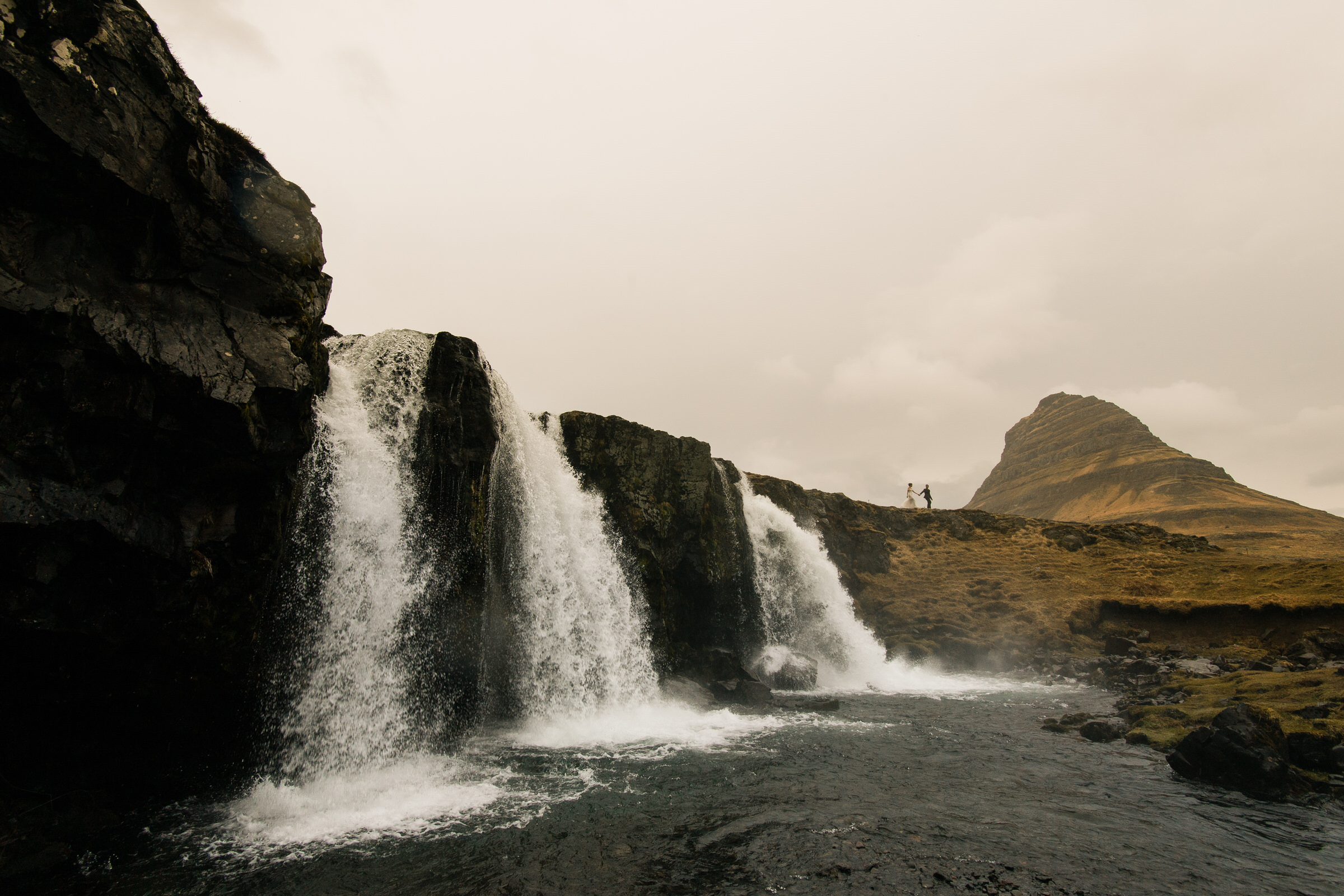 Couple at epic triple waterfall in Iceland - photo by M&J Studios