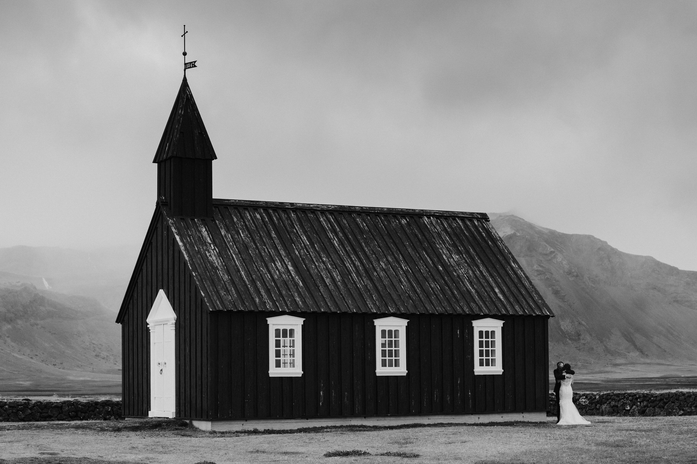 Couple at rustic church in Iceland - photo by M&J Studios