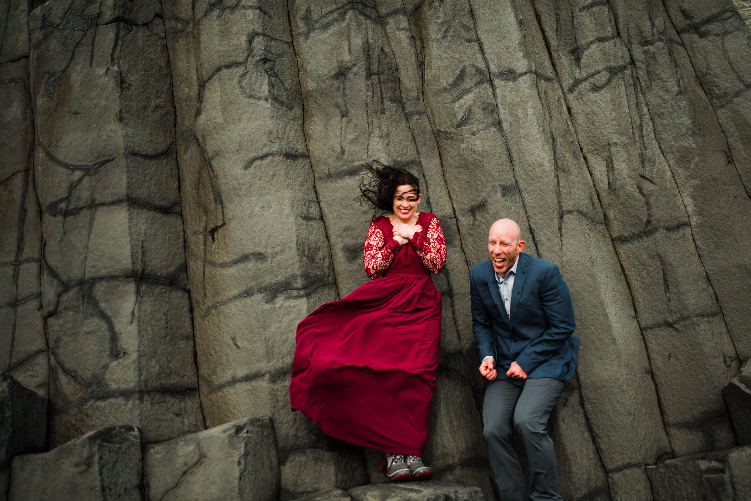Elopement couple against cold rock wall in Iceland - photo by M&J Studios