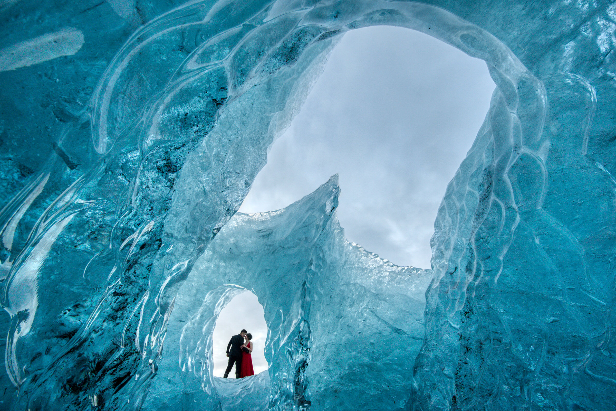 Elopement couple against Icelandic ice formation - photo by M&J Studios