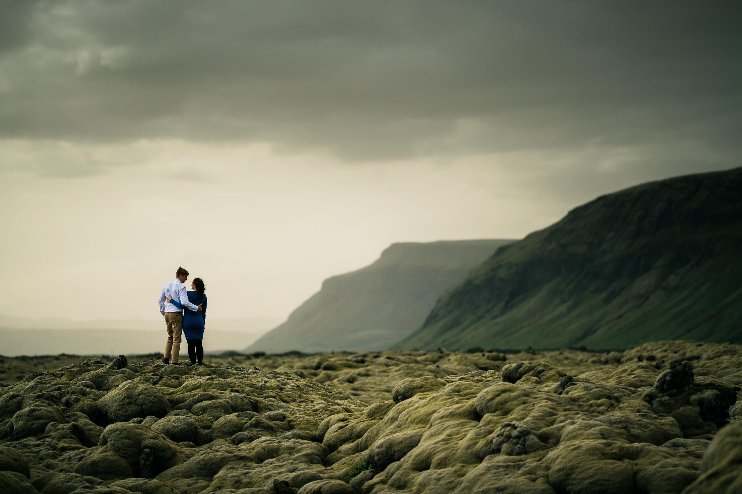 Elopement couple in stormy Icelandic landscape - photo by M&J Studios