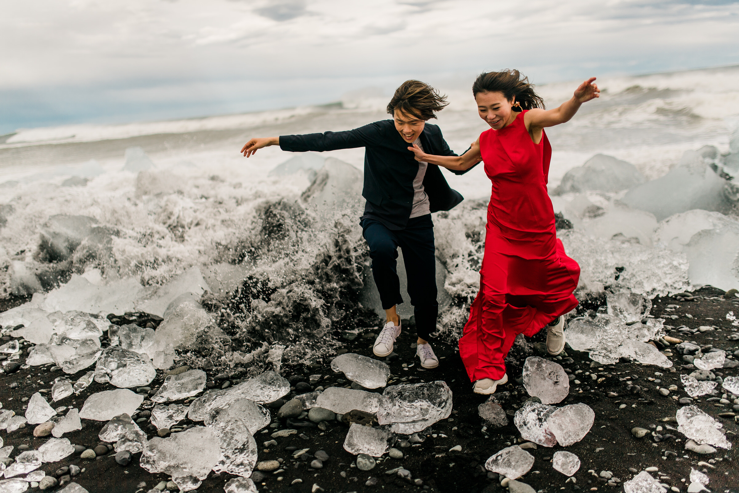 Elopement couple playing on ice in Iceland - photo by M&J Studios