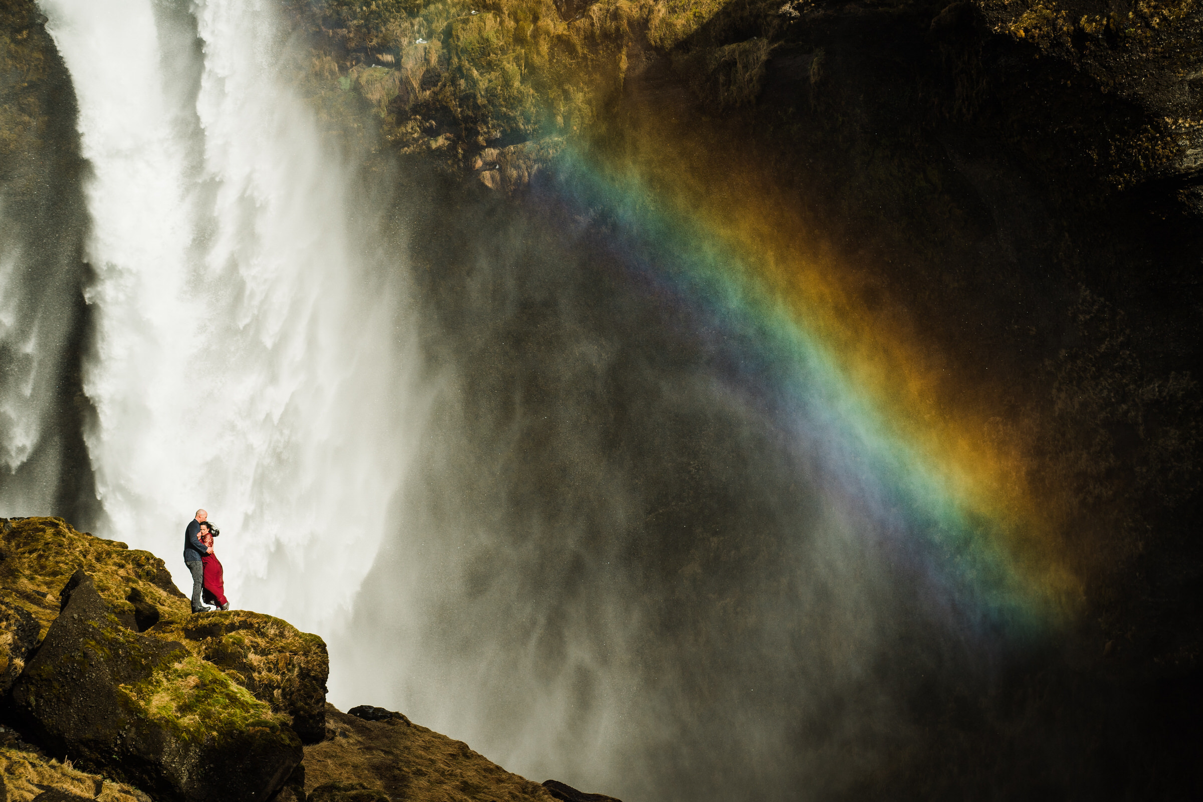 Iceland waterfall rainbow with elopement couple - photo by M&J Studios