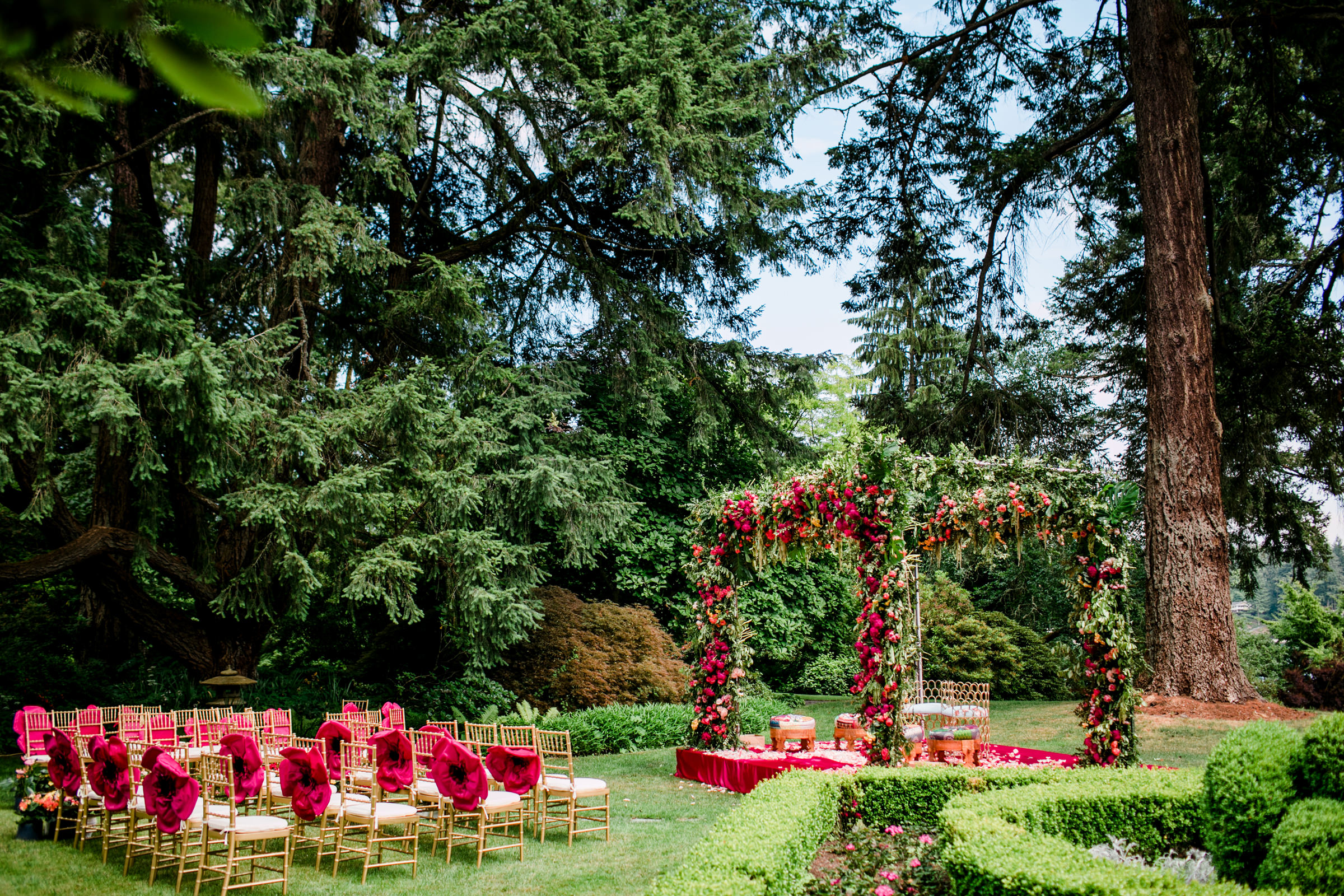 Double floral arbor in ceremony setting - photo by Into Dust Photography