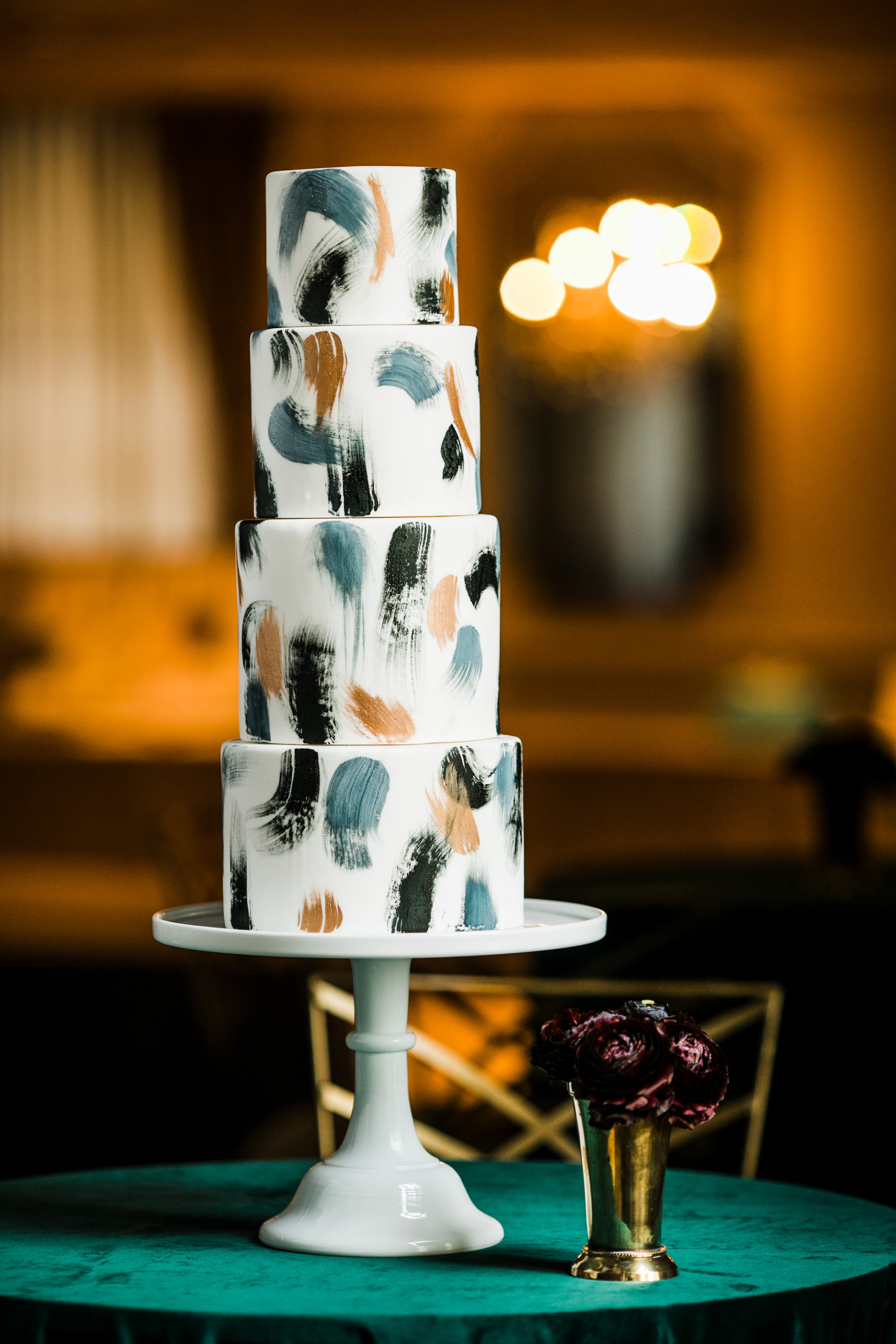 Four tier wedding cake with abstract designs - photo by Into Dust Photography