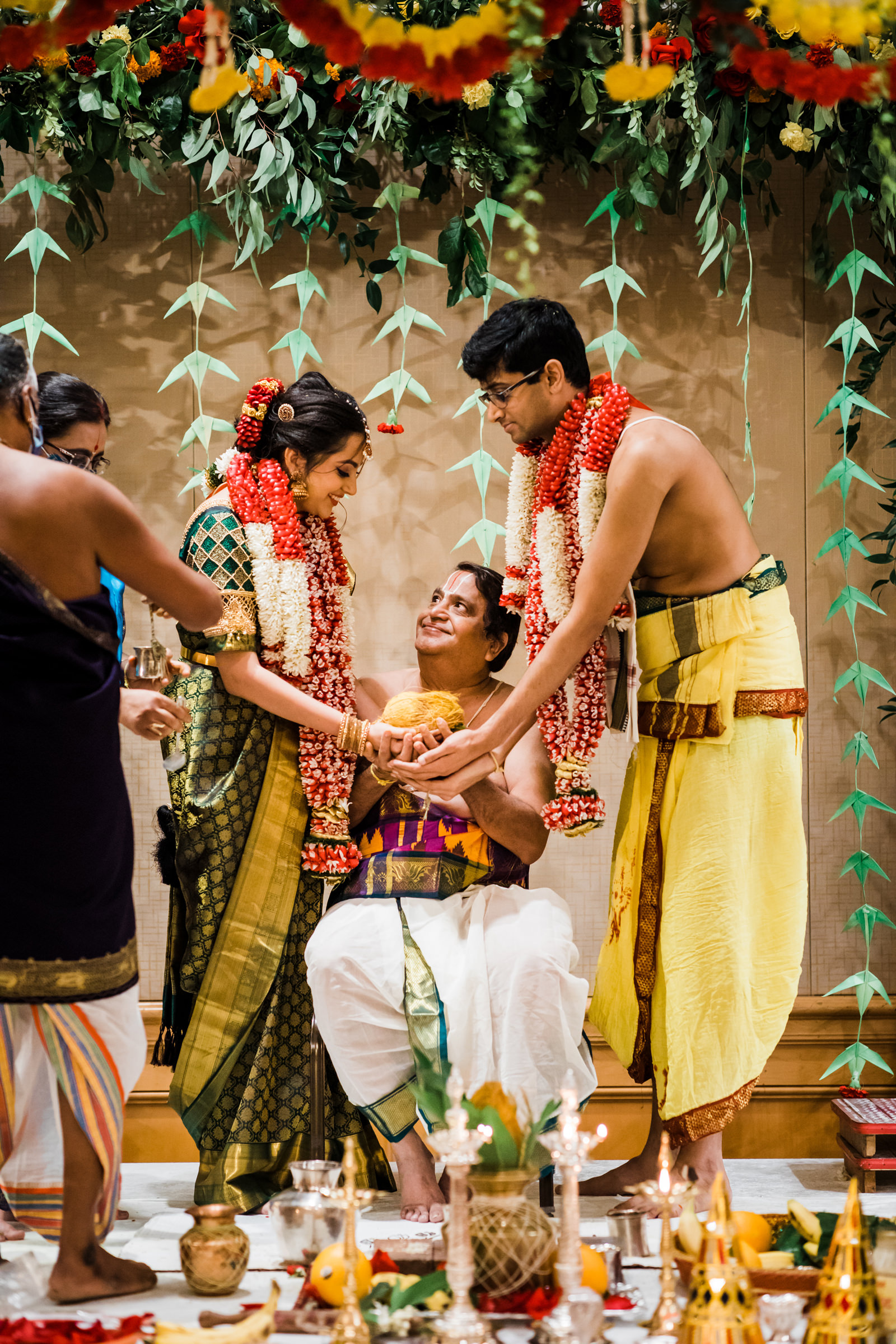 Indian couple ceremony with smiling father - photo by Into Dust Photography