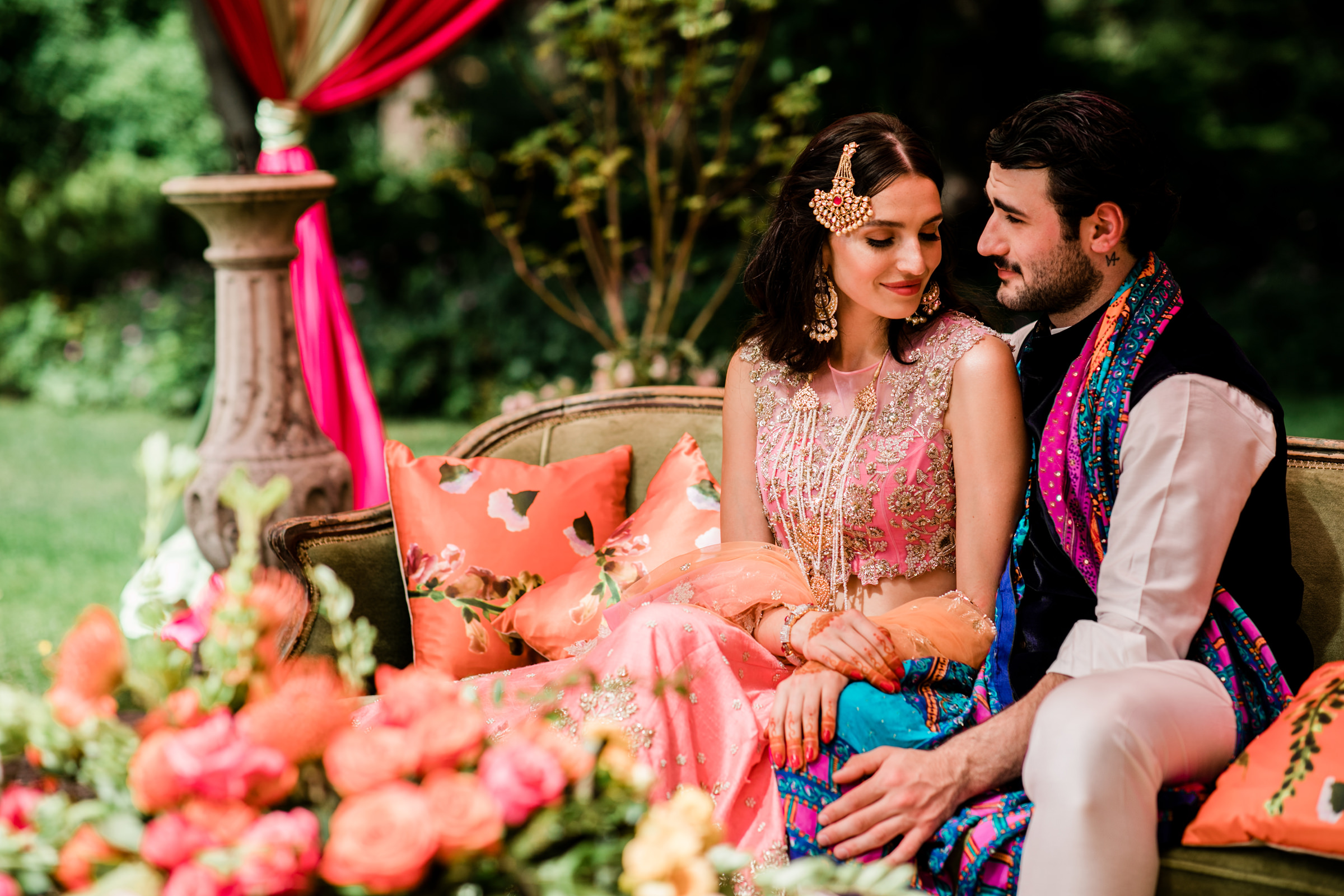 Seated outdoor portrait of Indian couple - photo by Into Dust Photography