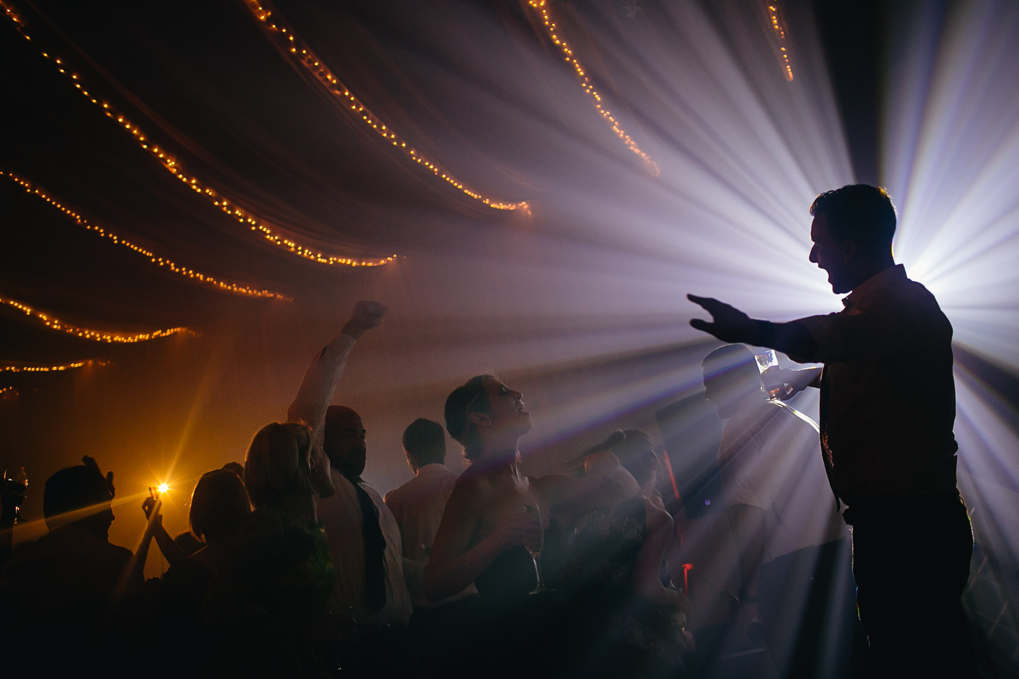 Party moment against spotlight - photo by Caroline's Collective