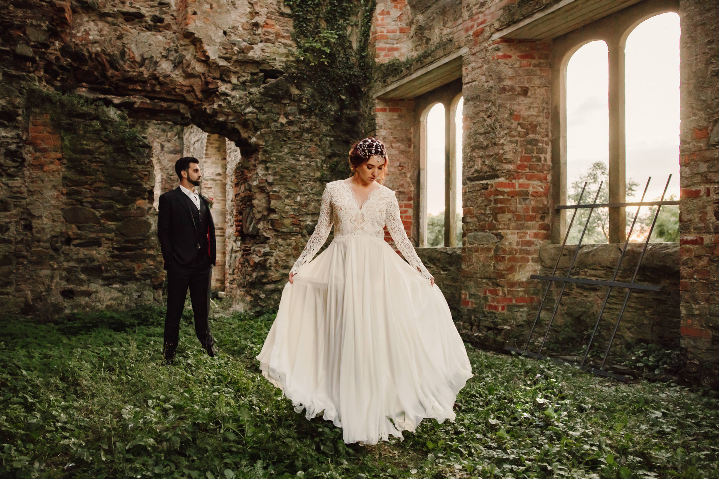 Bride and groom portrait amid building ruin in Ireland - photo by Lima Conlon Photography