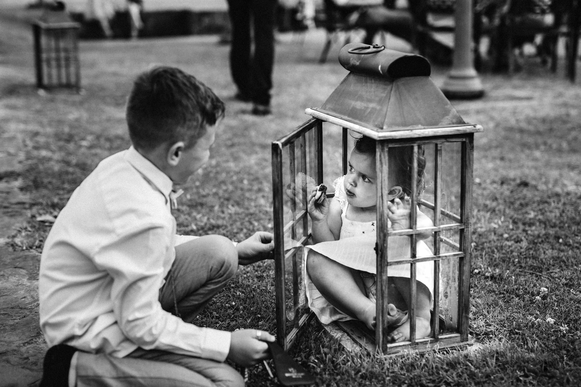 Brother attempts to lock little sister in small container - photo by Lima Conlon Photography