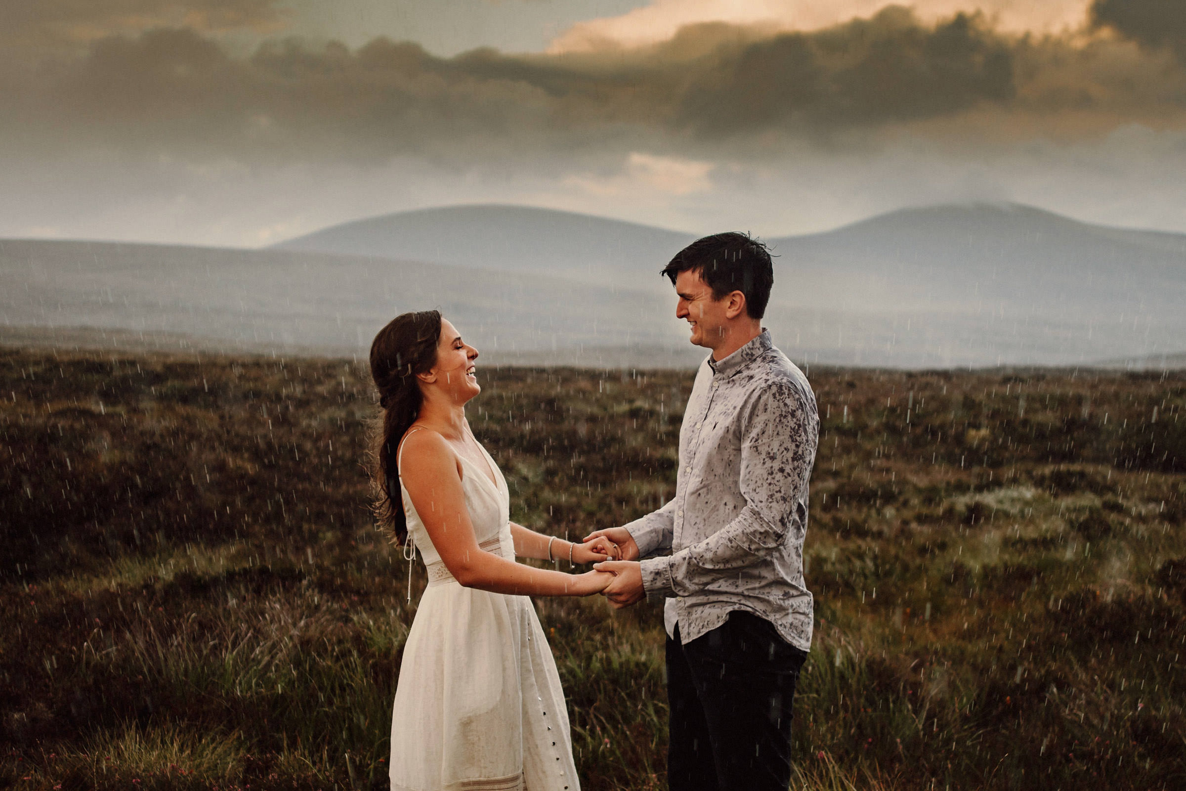 Couple holding hands in the rain in Ireland - photo by Lima Conlon Photography