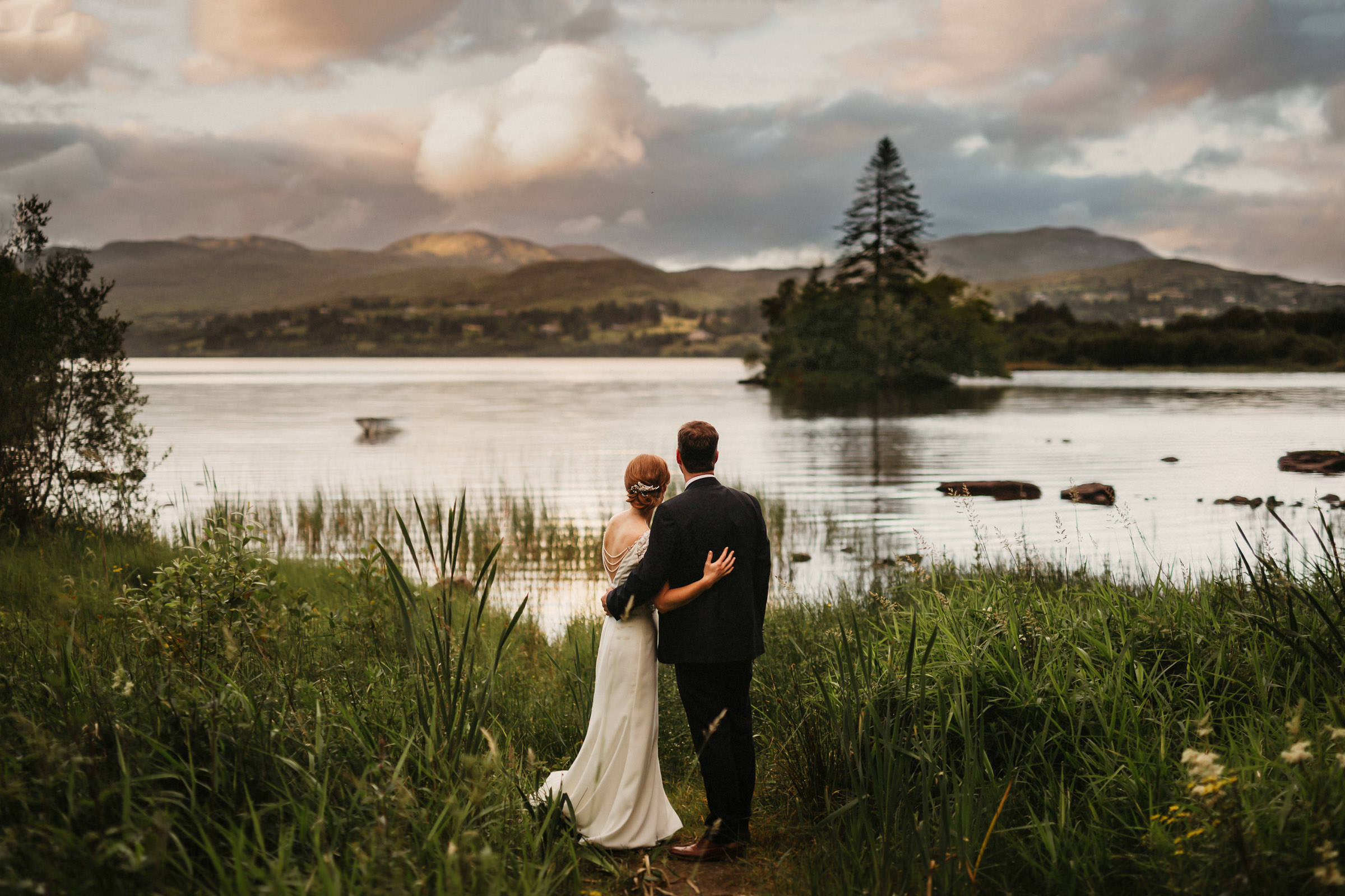 Couple looks out on lake in Ireland - photo by Lima Conlon Photography
