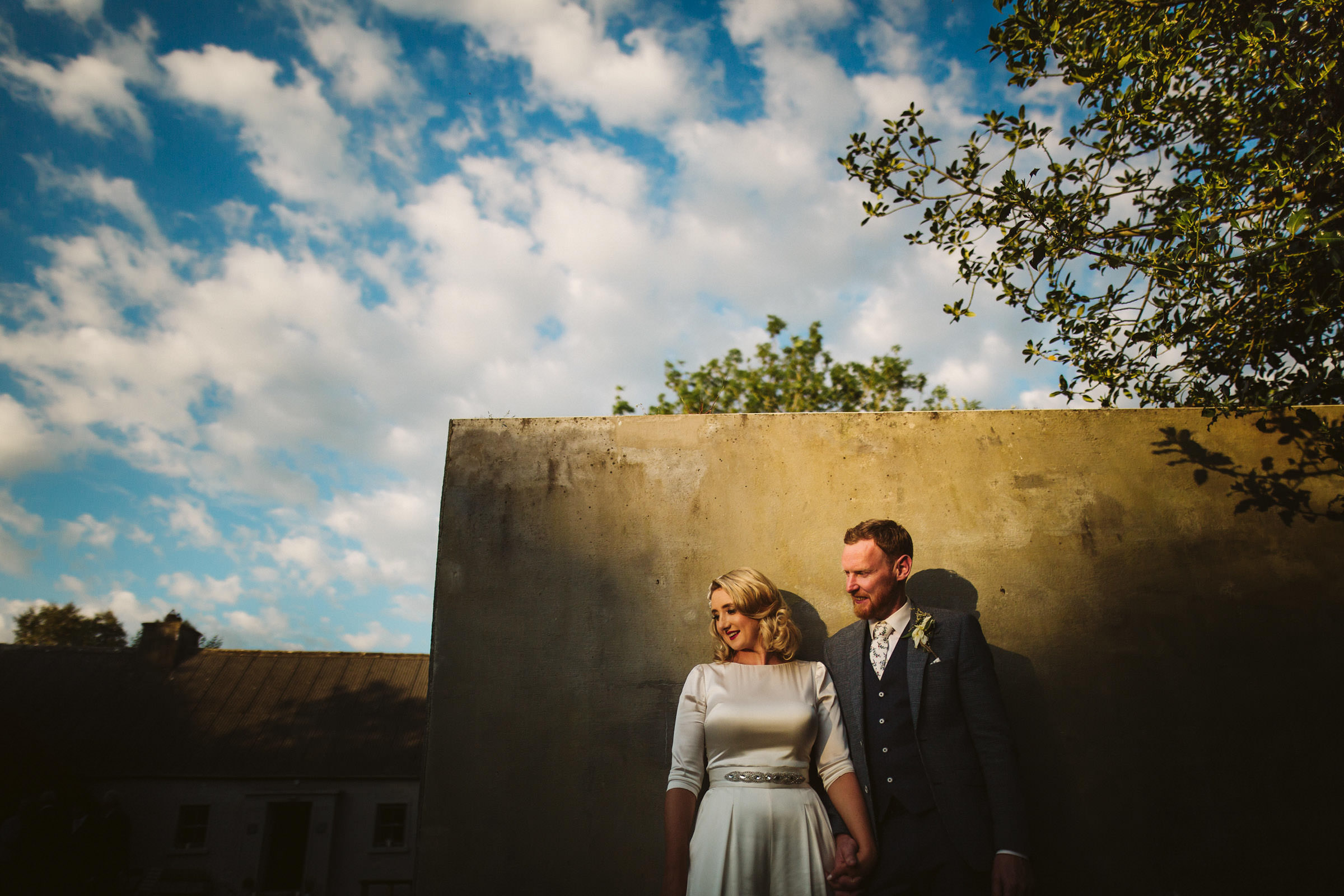 Couple portrait against wall - photo by Lima Conlon Photography