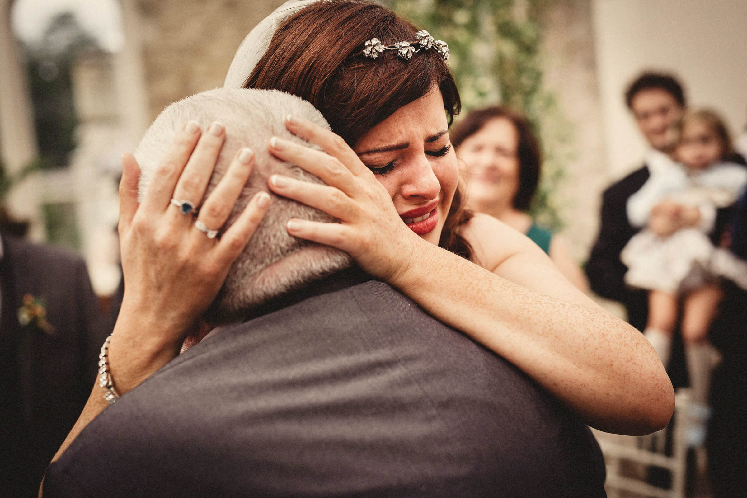 Emotional embrace by bride - photo by Lima Conlon Photography