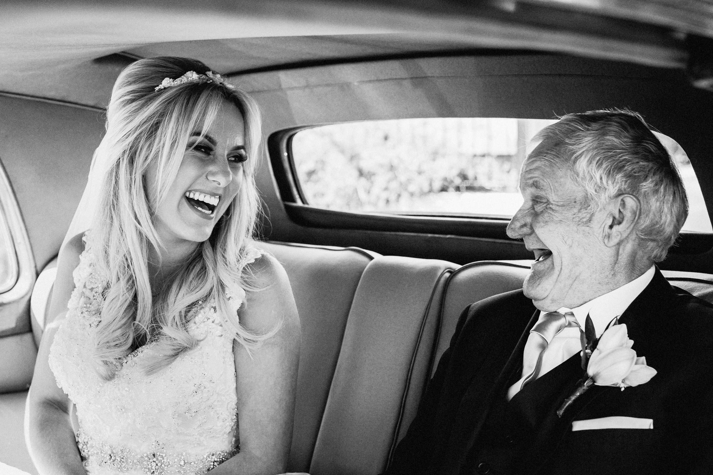 Laughing bride and grandfather in limo - photo by Lima Conlon Photography