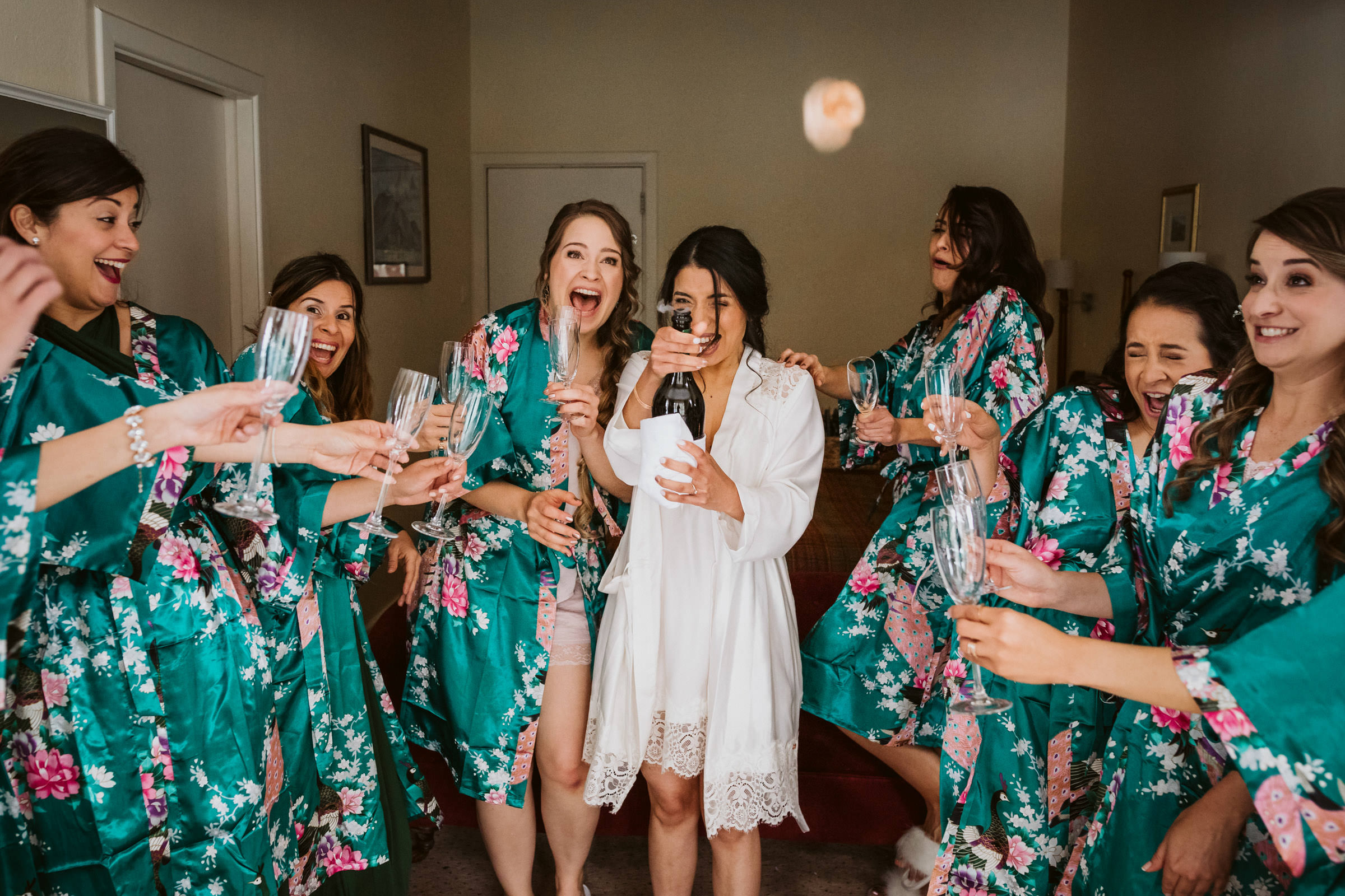 Laughing bridesmaids with bride taking selfie - photo by Lima Conlon Photography