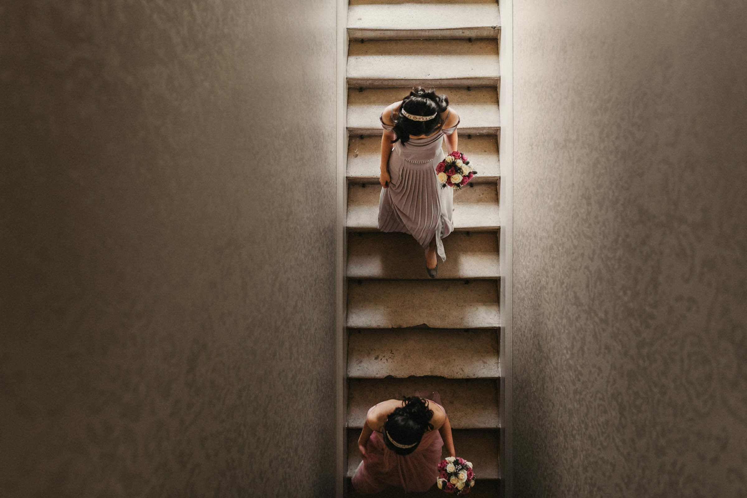 Top down view of flower girls descending stairs- photo by Lima Conlon Photography