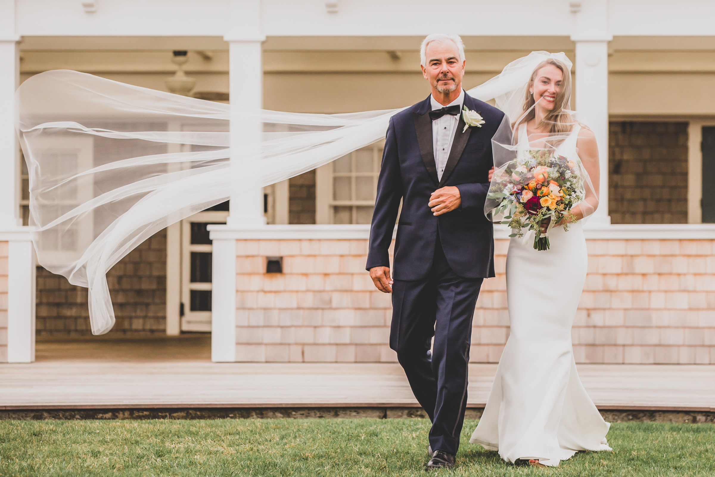 Bride links arms with father - photo by Katie Kaizer Photography