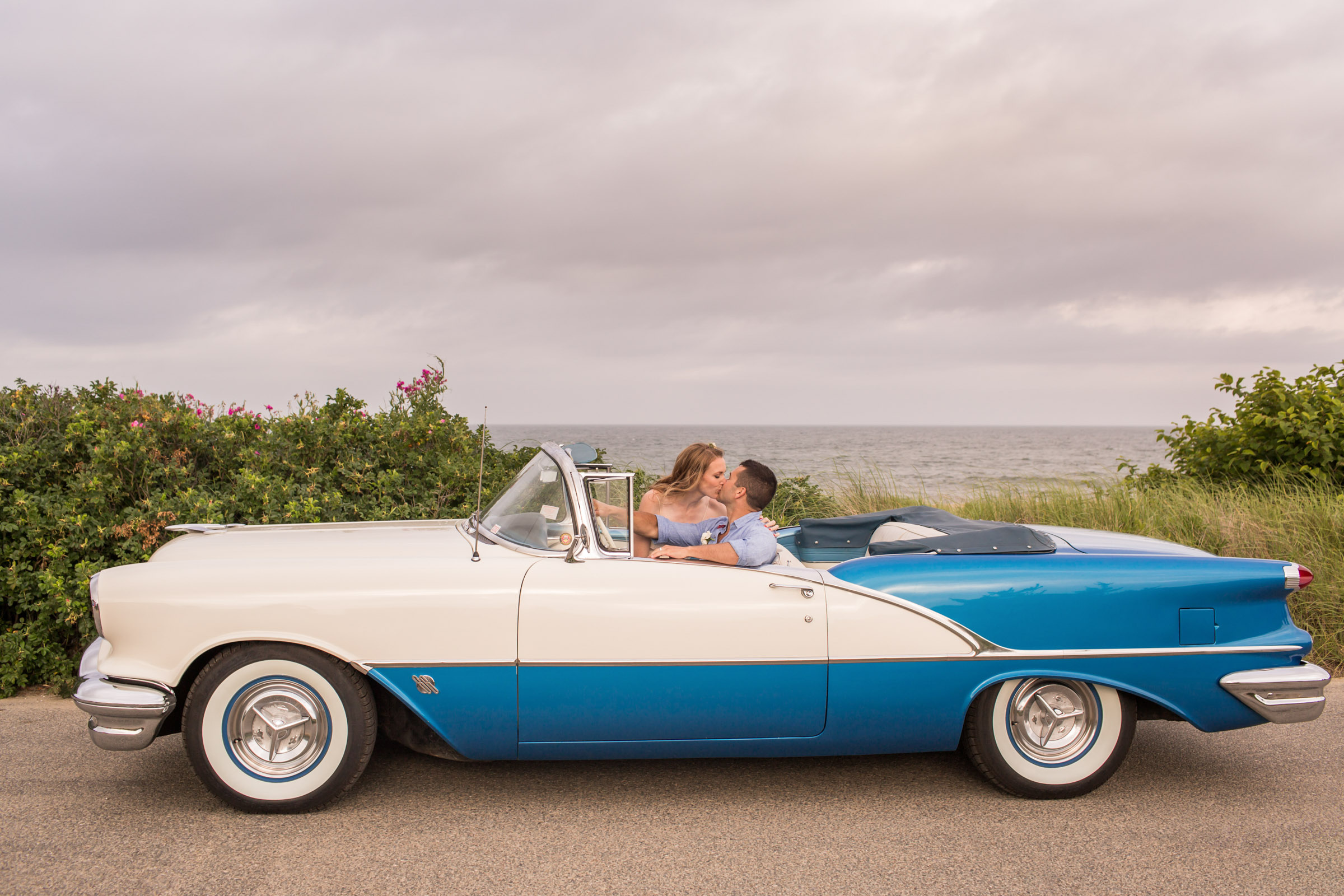 Couple kiss in vintage auto at Cape Cod - photo by Katie Kaizer Photography