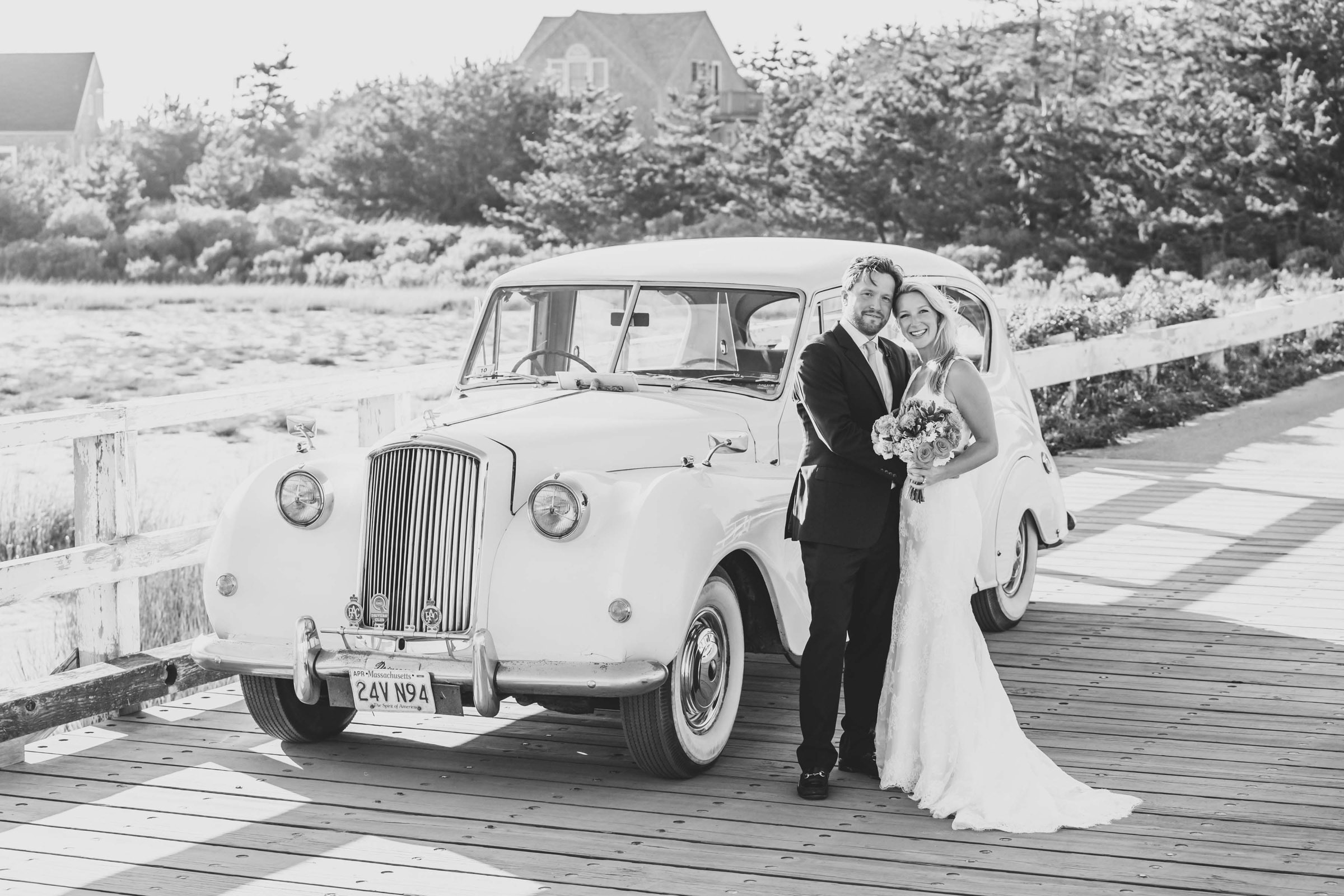 Couple with vintage auto - photo by Katie Kaizer Photography