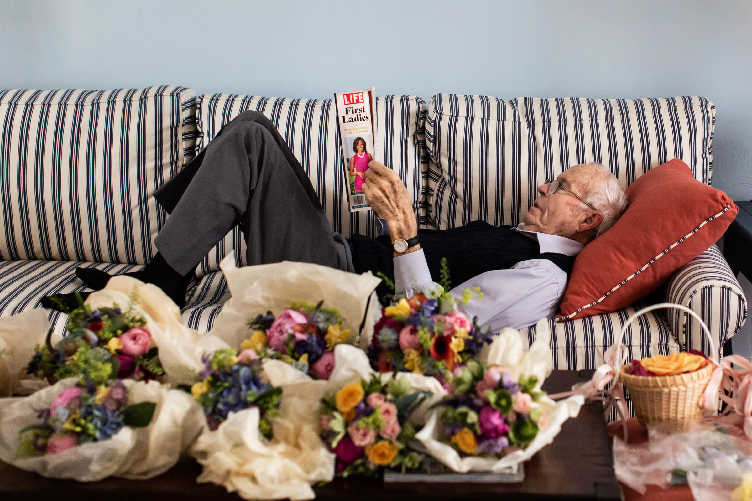 Lounging grandfather reading Life magazine - photo by Katie Kaizer Photography