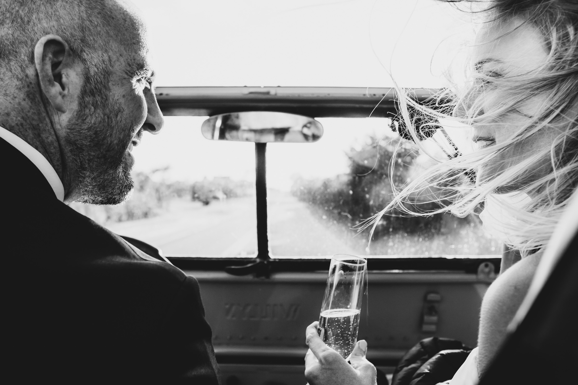 sipping Champagne in the car- photo by Katie Kaizer Photography