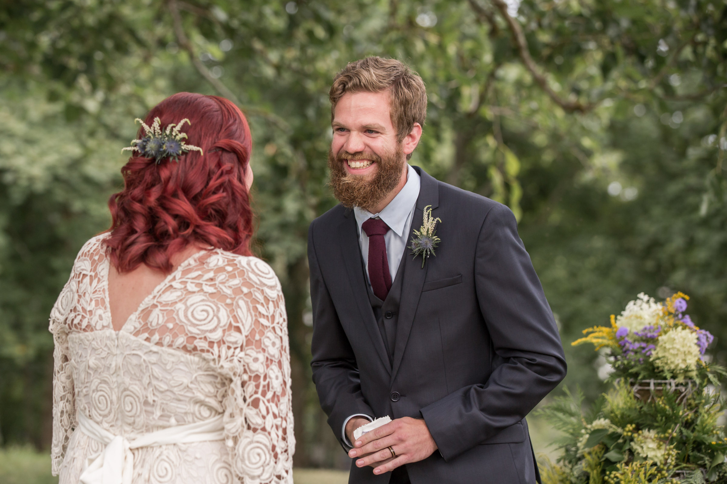Smiling groom leans in toward bride - photo by Katie Kaizer Photography